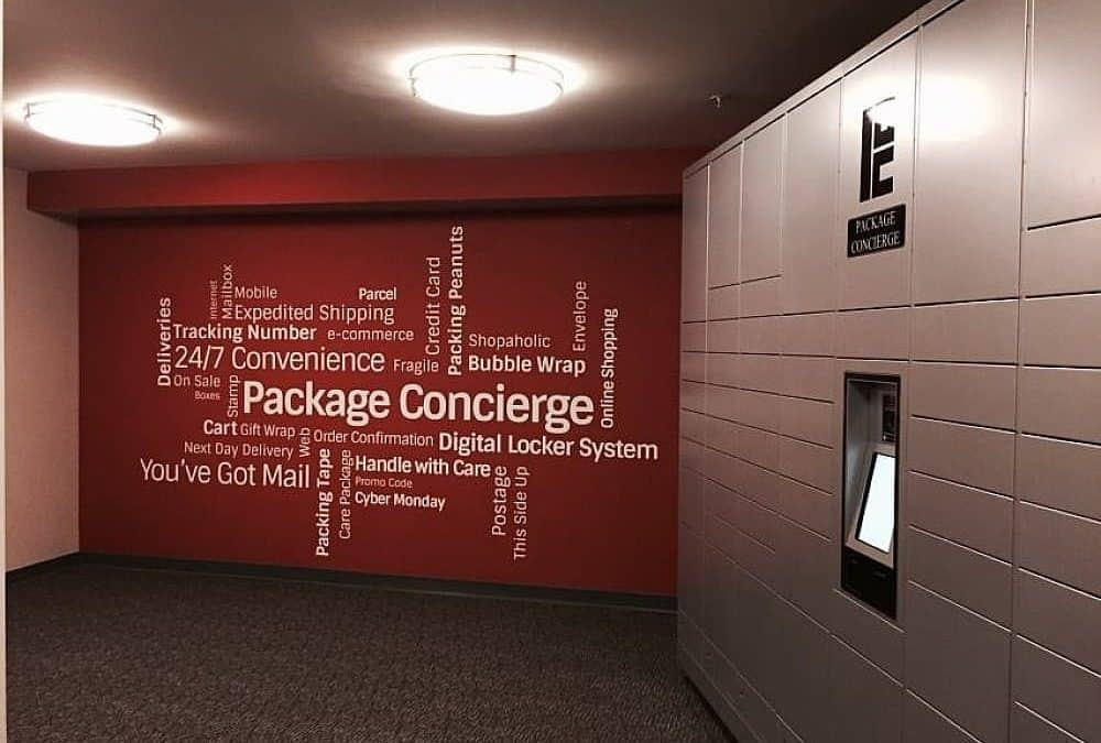 Automated locker next to wall with word cloud
