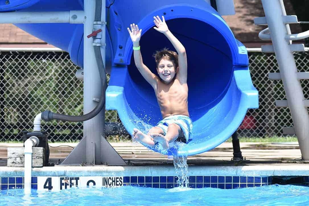 A child having fun on a water slide
