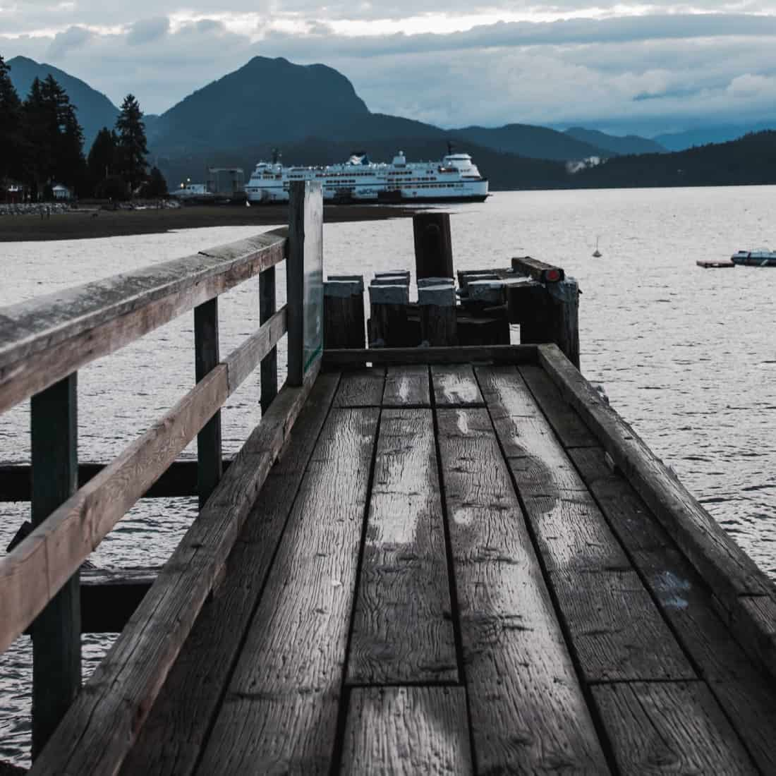 Watching a ferry from a dock on Vancouver Island