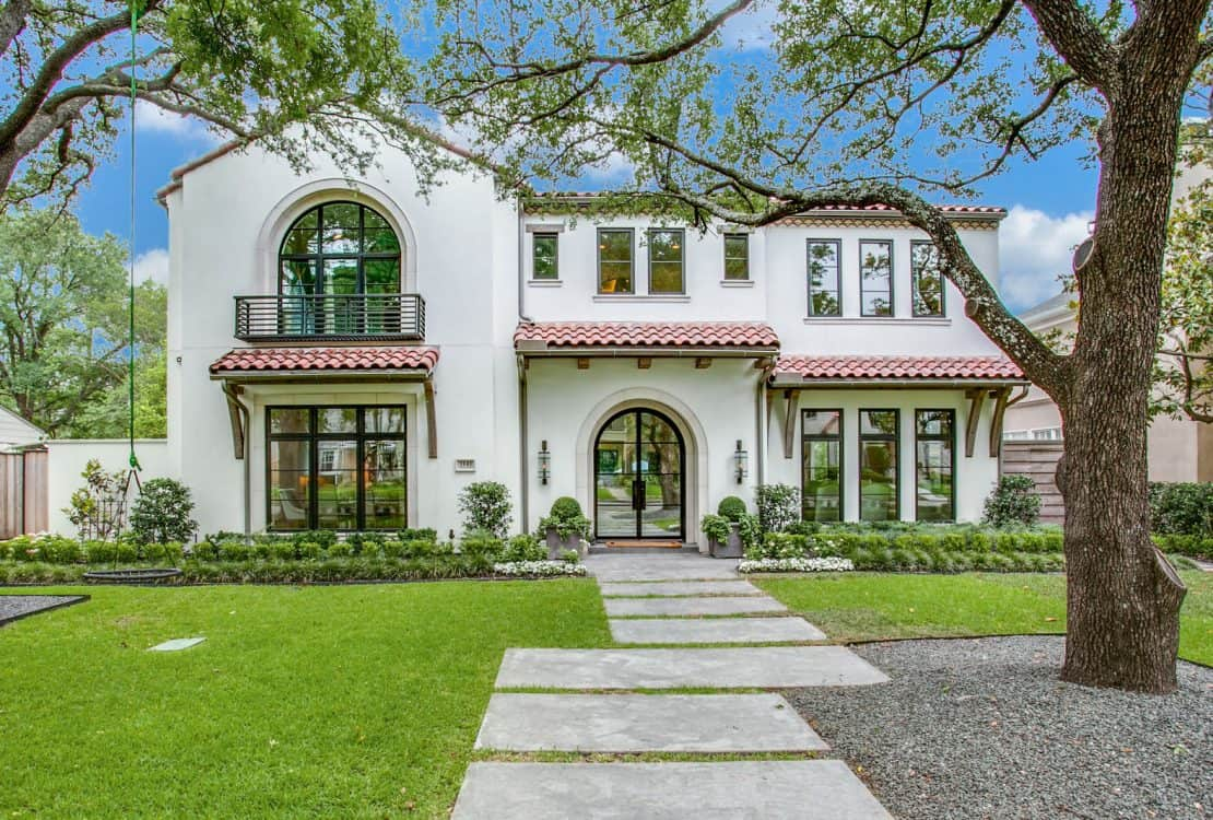 a mediterranean exterior with Tuscan white stucco wall and off-white trim