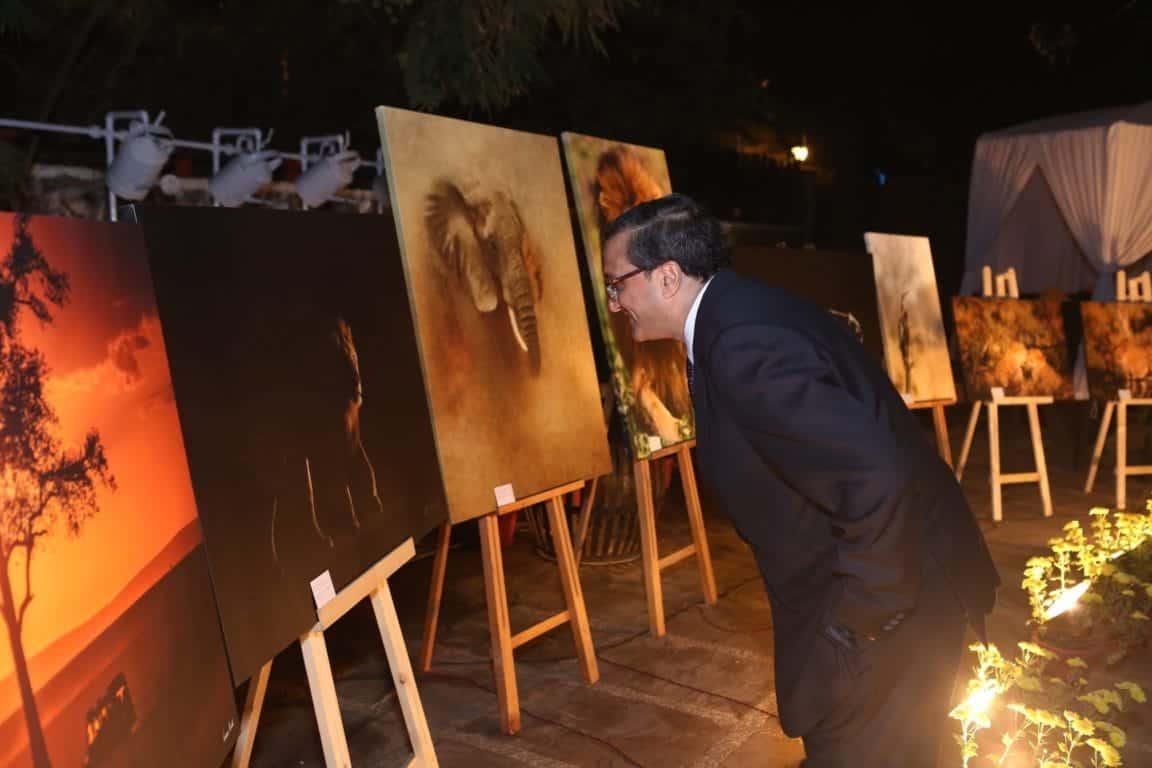 S.K. Srivastava, Former Secretary, Government of India, admiring the photographs