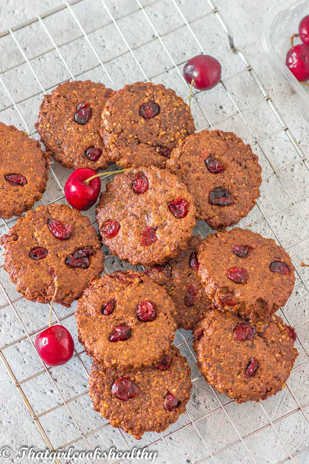 cookies with loose cherries on top