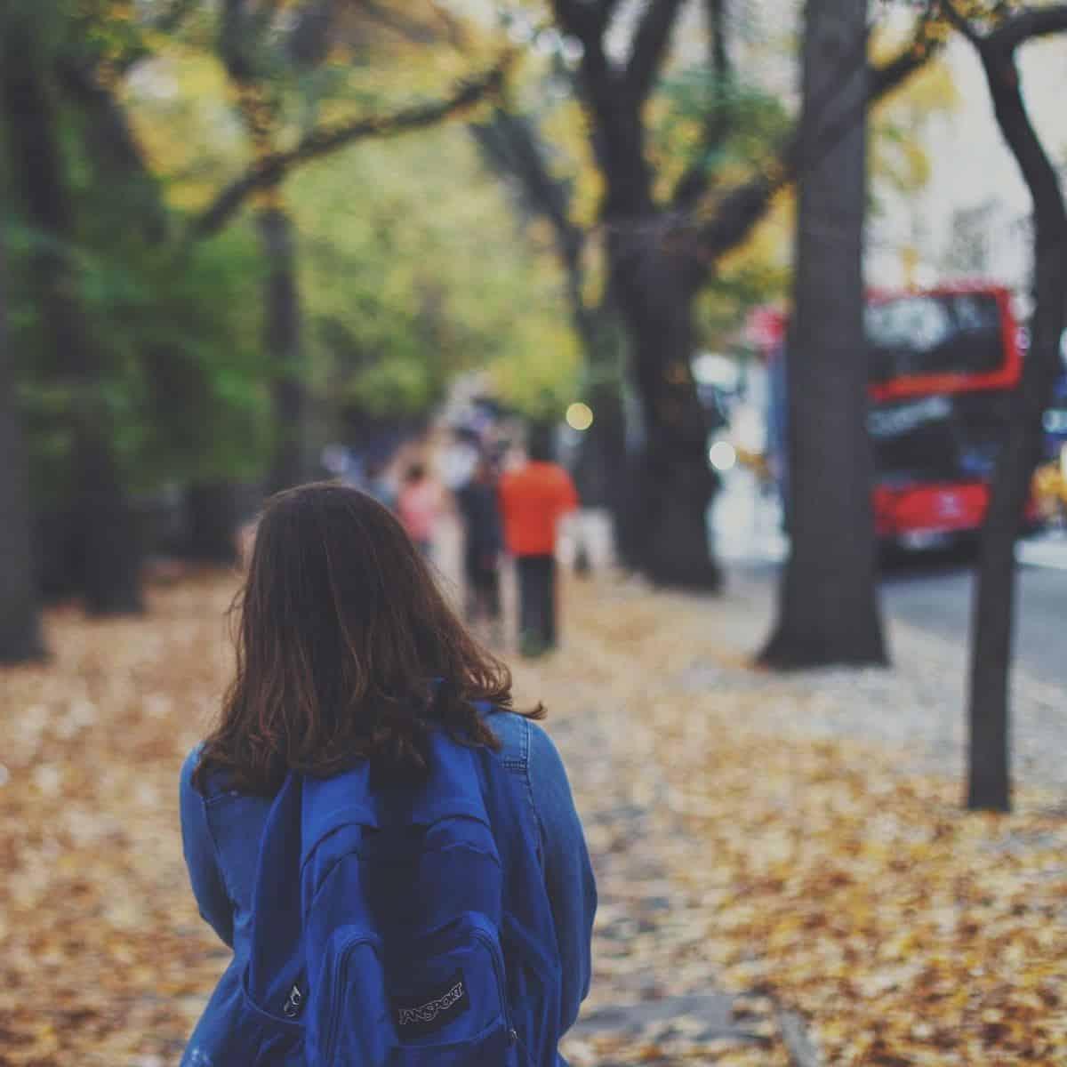 teen girl near a bus stop