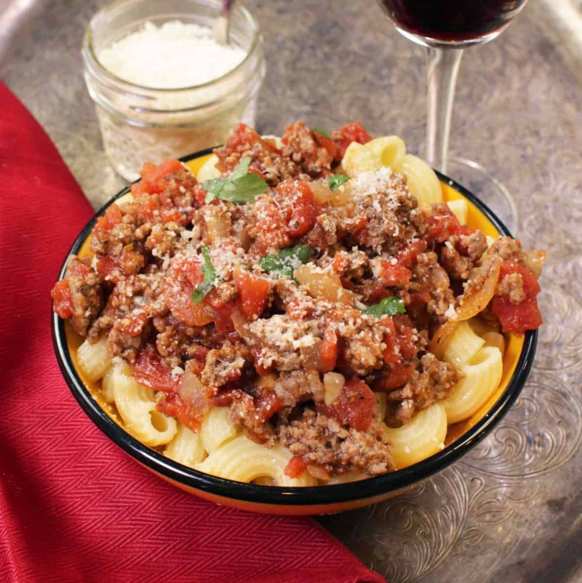 a bowl of ground beef meat sauce.