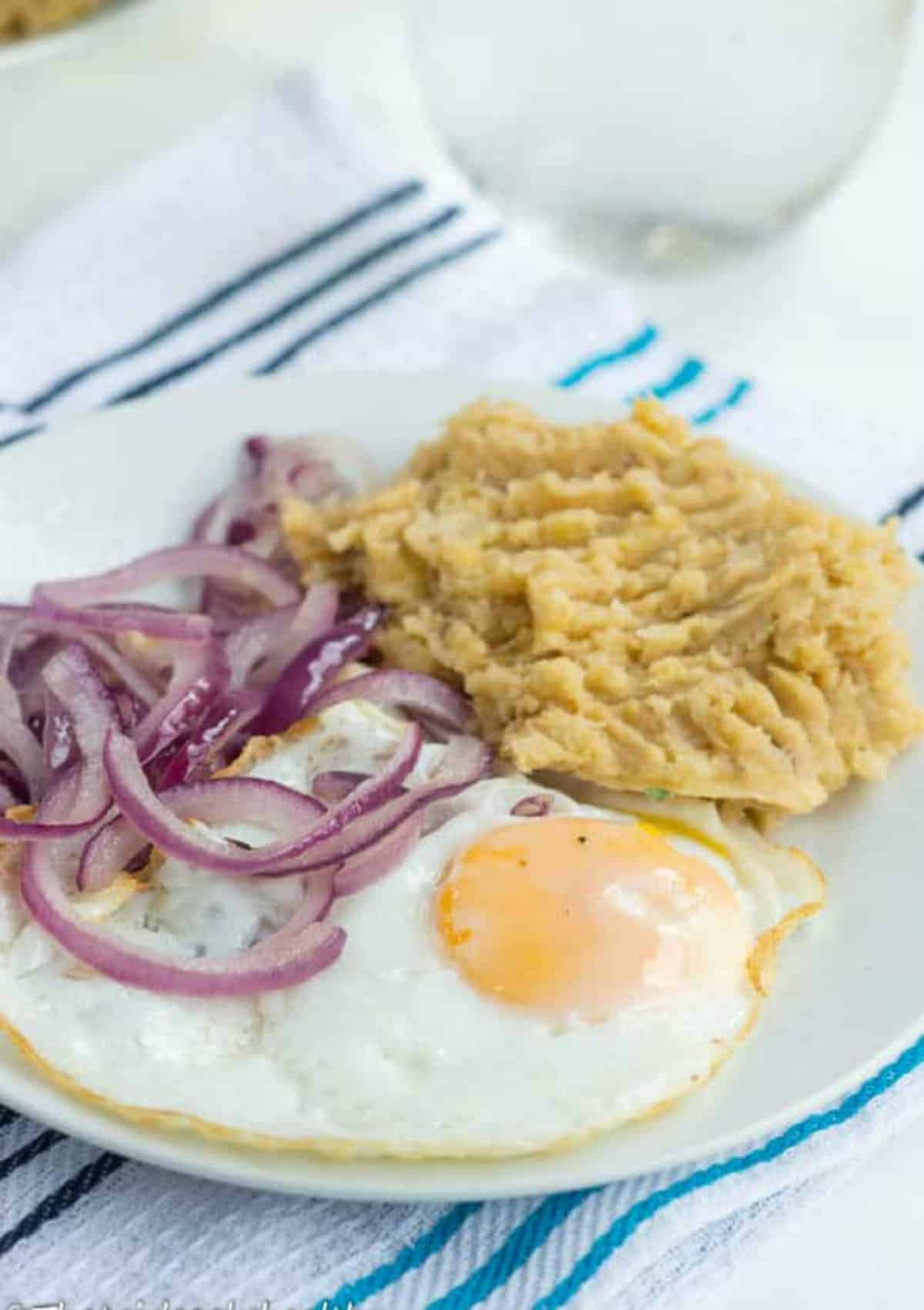 Eggs, red onions and plantains