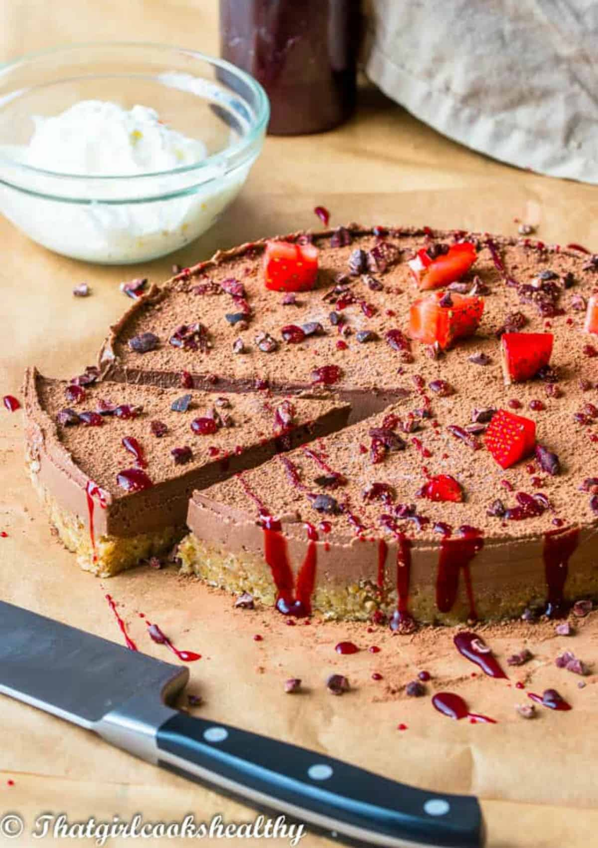 slicing a portion of chocolate cheesecake