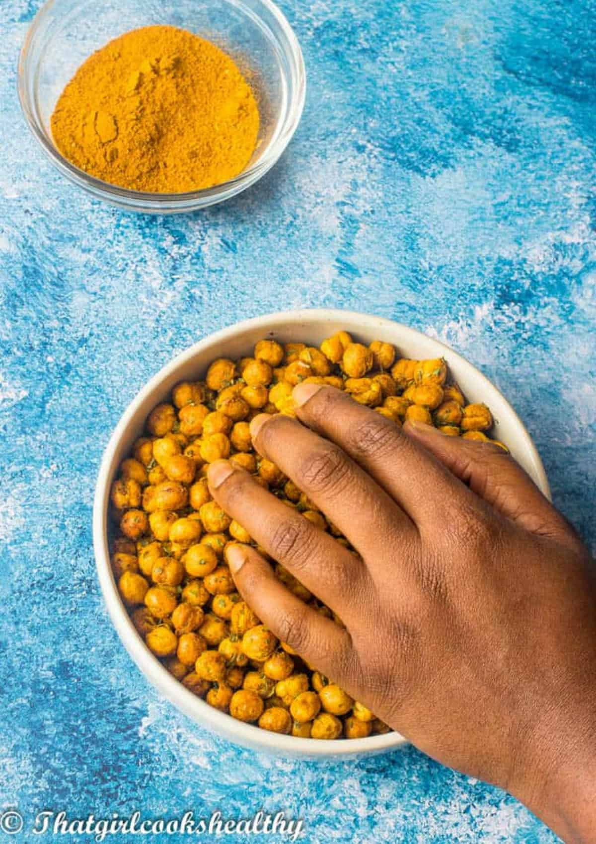 hand touching the chickpeas