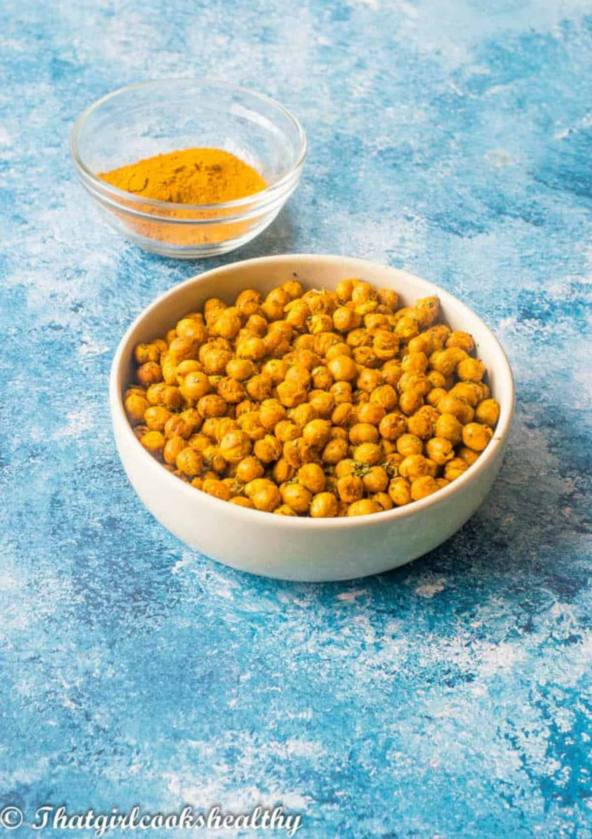chickpeas in a bowl with curry powder in another bowl
