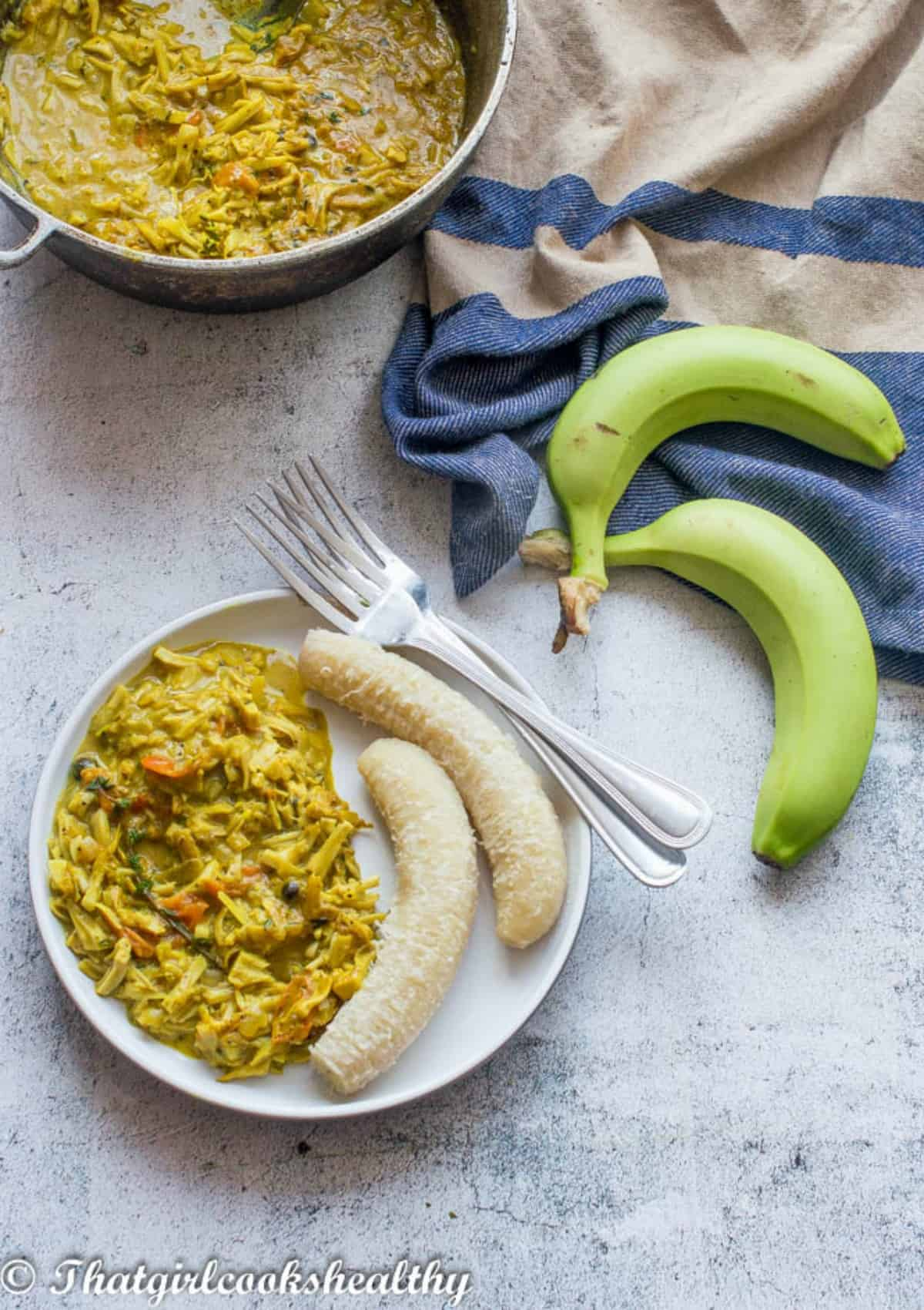 plate of food with green bananas