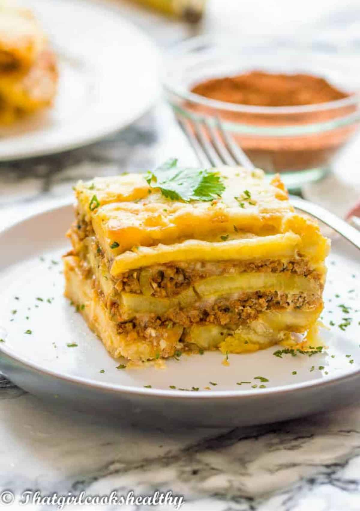 lasagna with fork resting on the right