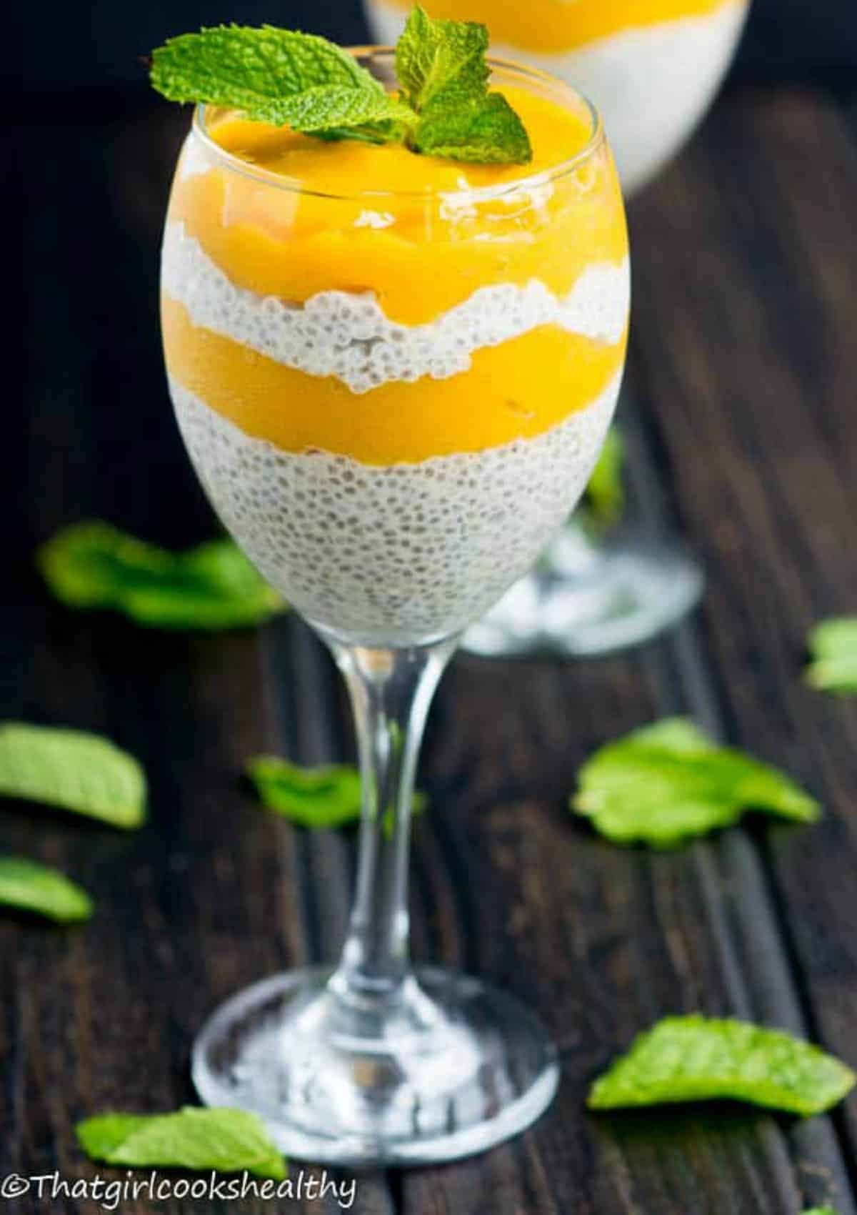 layered chia seed pudding with mint leaves