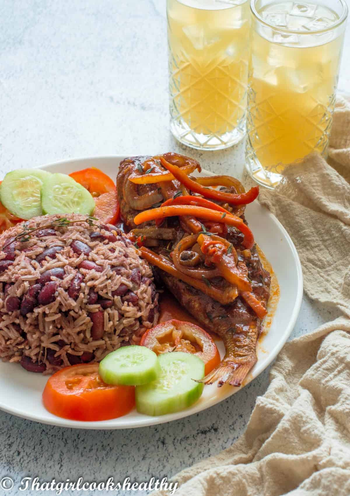 stewed fish with rice and a drink