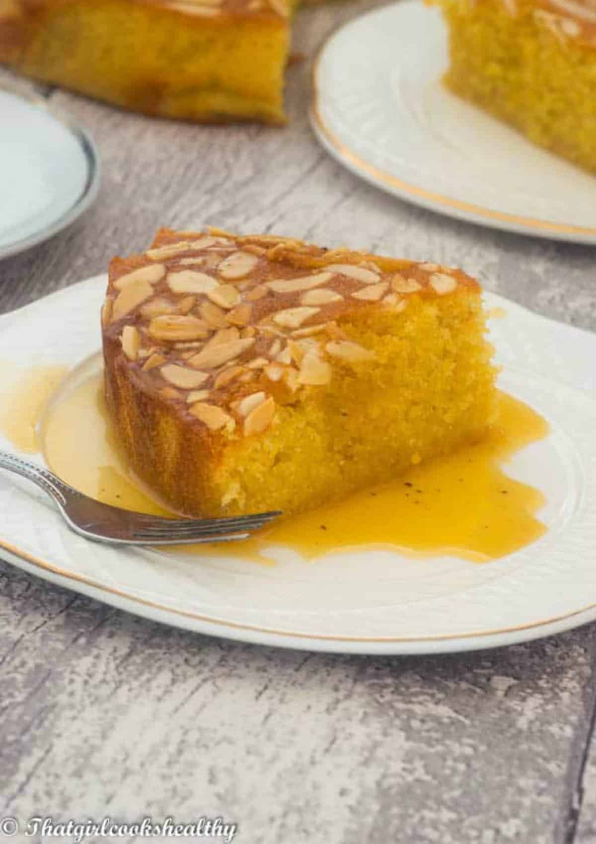 syrup drizzled onto the cake