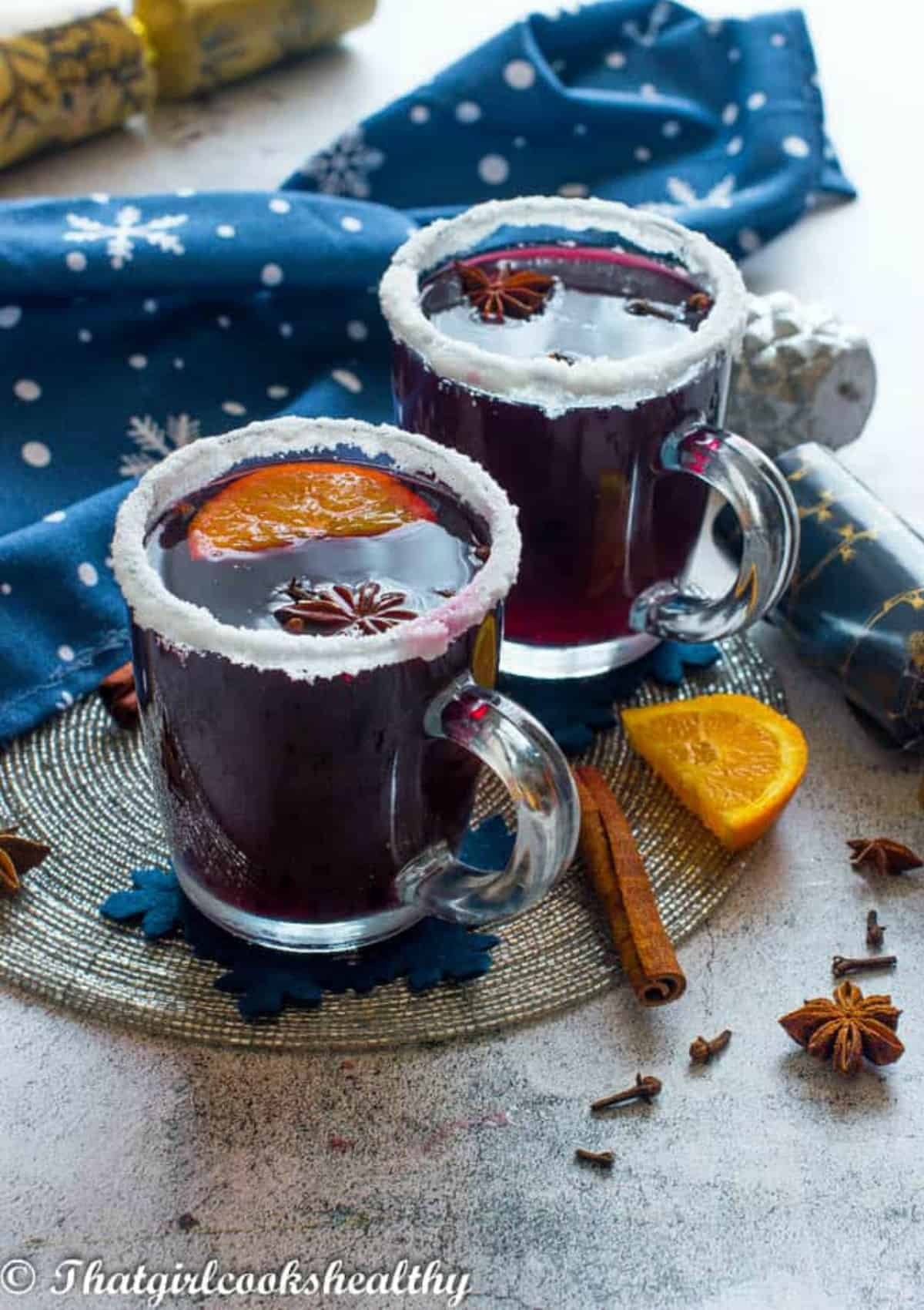 two decorated cups of mulled wine