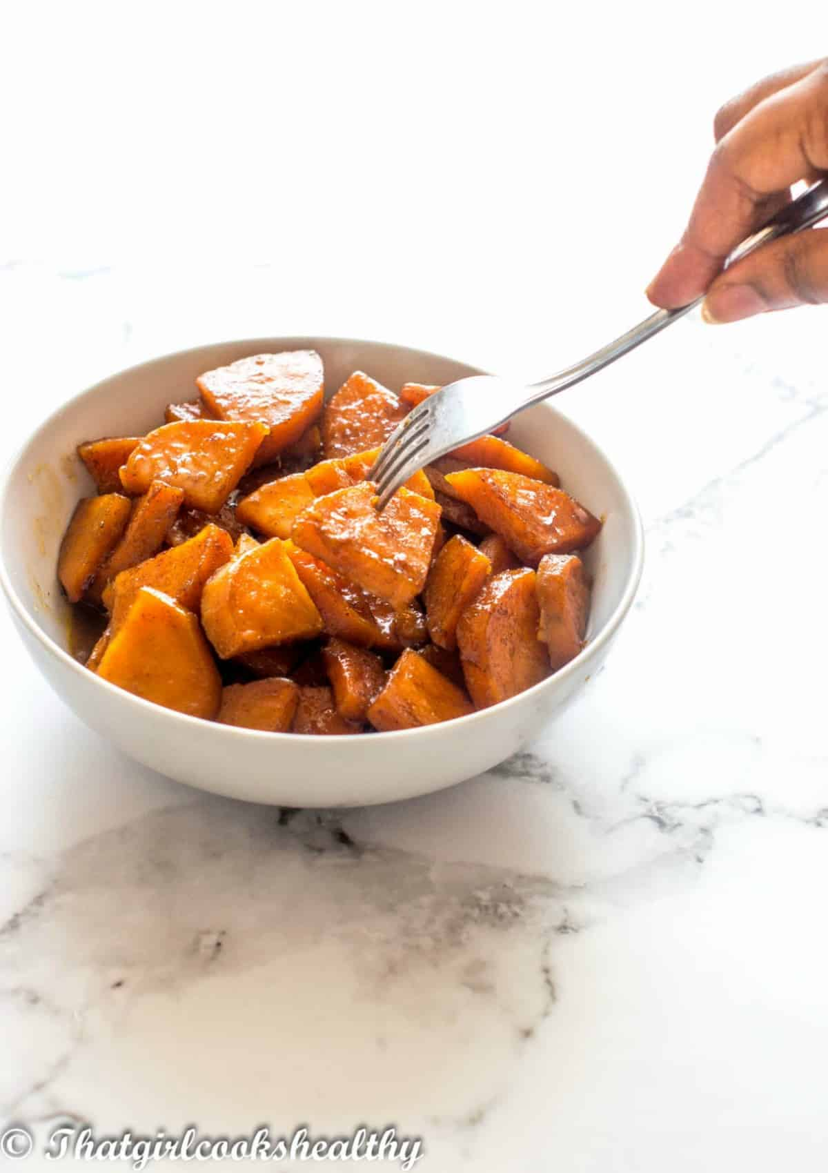 grabbing the yams with a fork