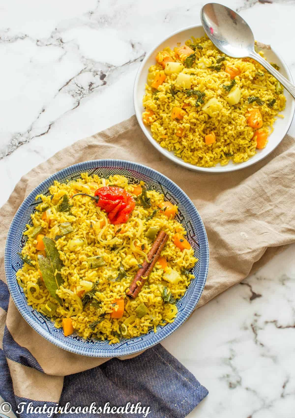 plate and a dish of yellow rice