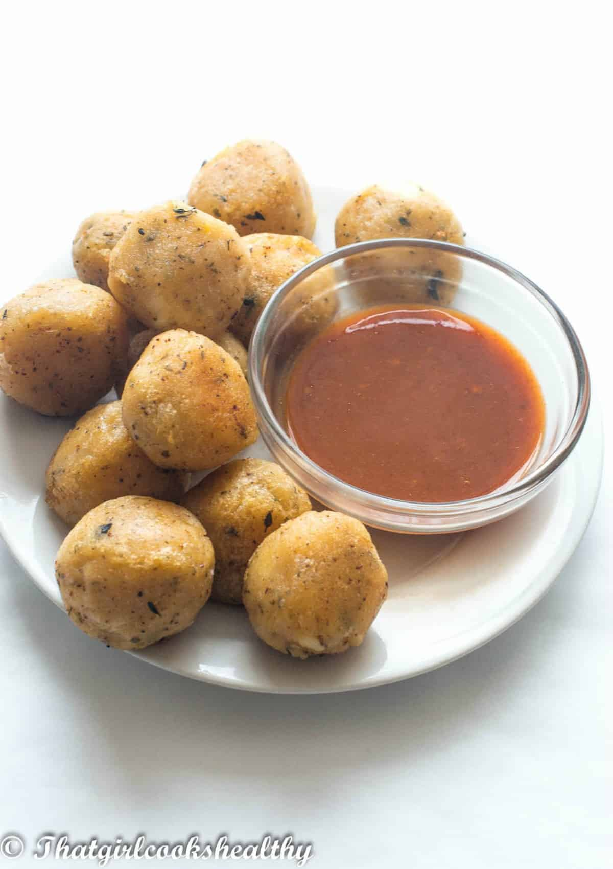 Cheese balls on a plate with sauce