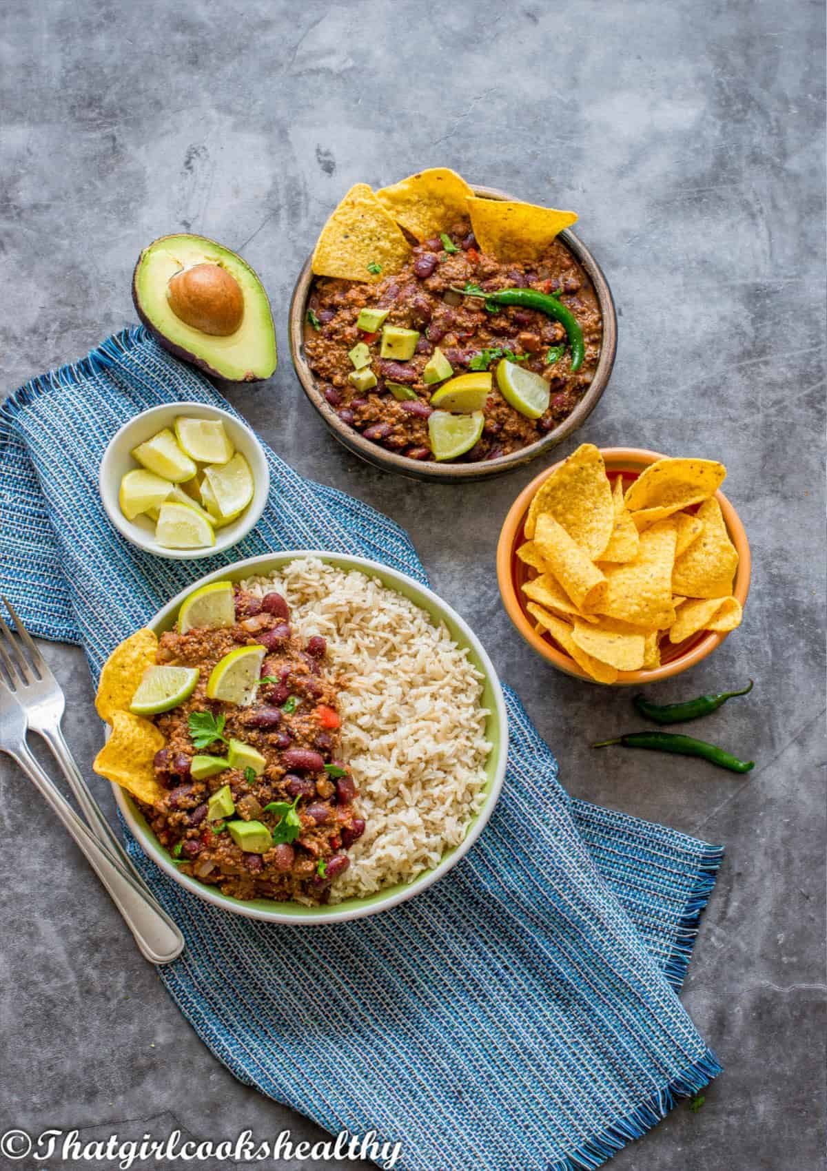 lamb with rice garnish with avocadoes and lime
