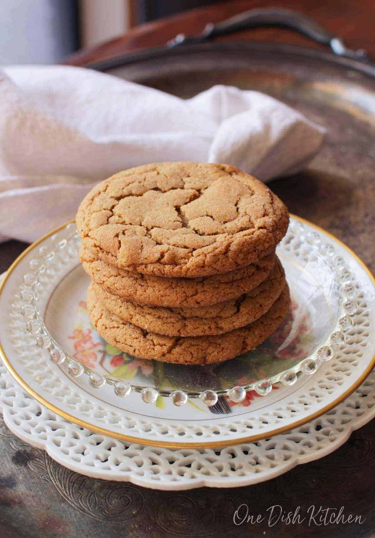 A stack of four soft ginger cookies plated on a metal tray
