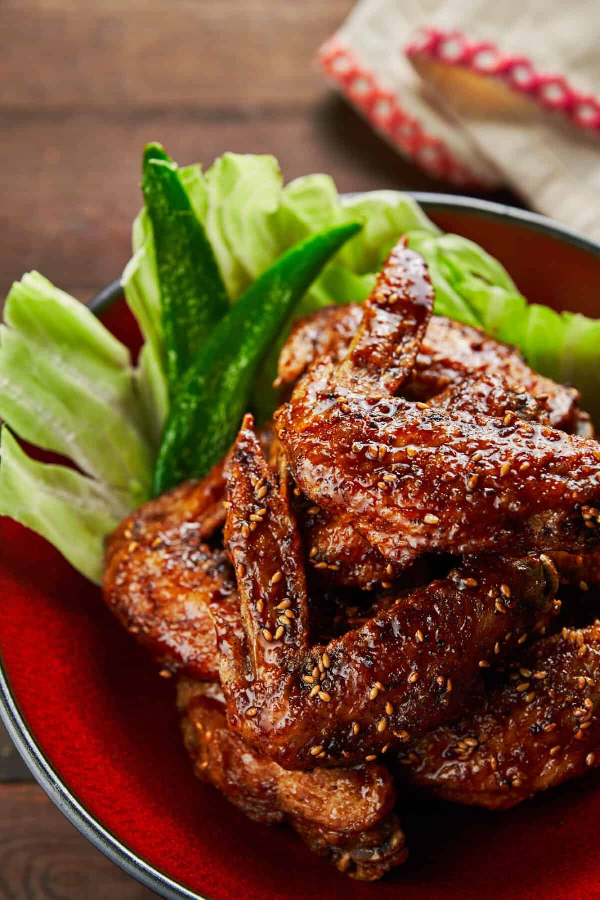Secrets to making the crispiest wings ever! Glazed in a sweet and savory sauce that's loaded with ginger, garlic and black pepper this Tebasaki recipe is dangerously addictive.