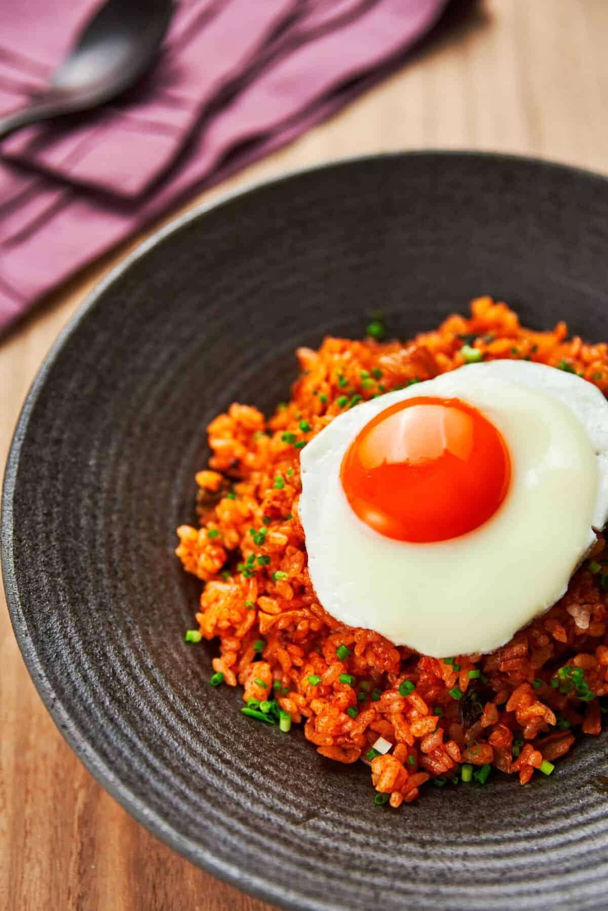 Spicy and loaded wtih flavor, this easy kimchi fried rice with a fried egg on top comes together from just a handful of ingredients.