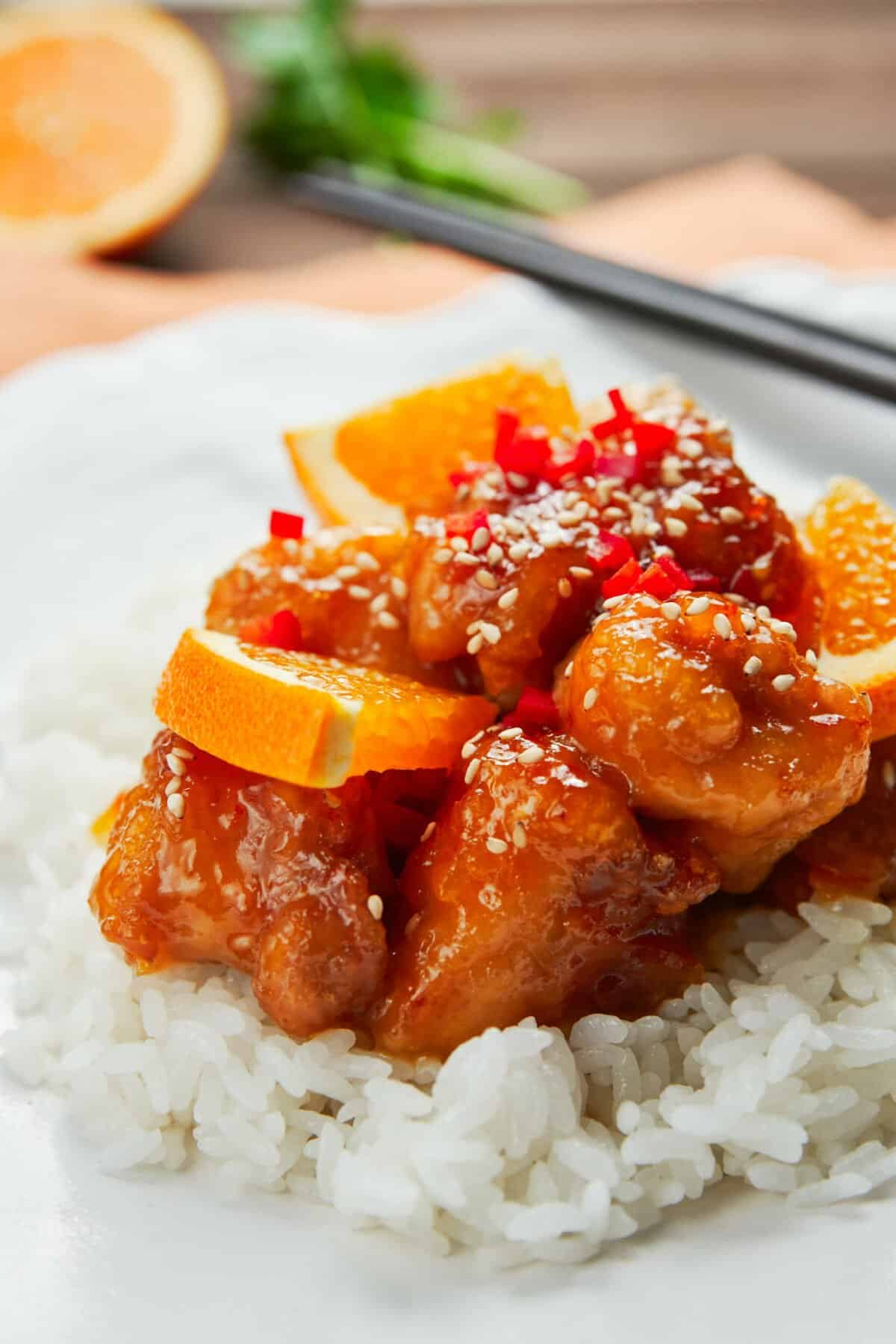 Crisp juicy fried chicken glazed in a sweet and sour orange sauce that's redolent of fresh citrus thanks to a triple dose of orange.