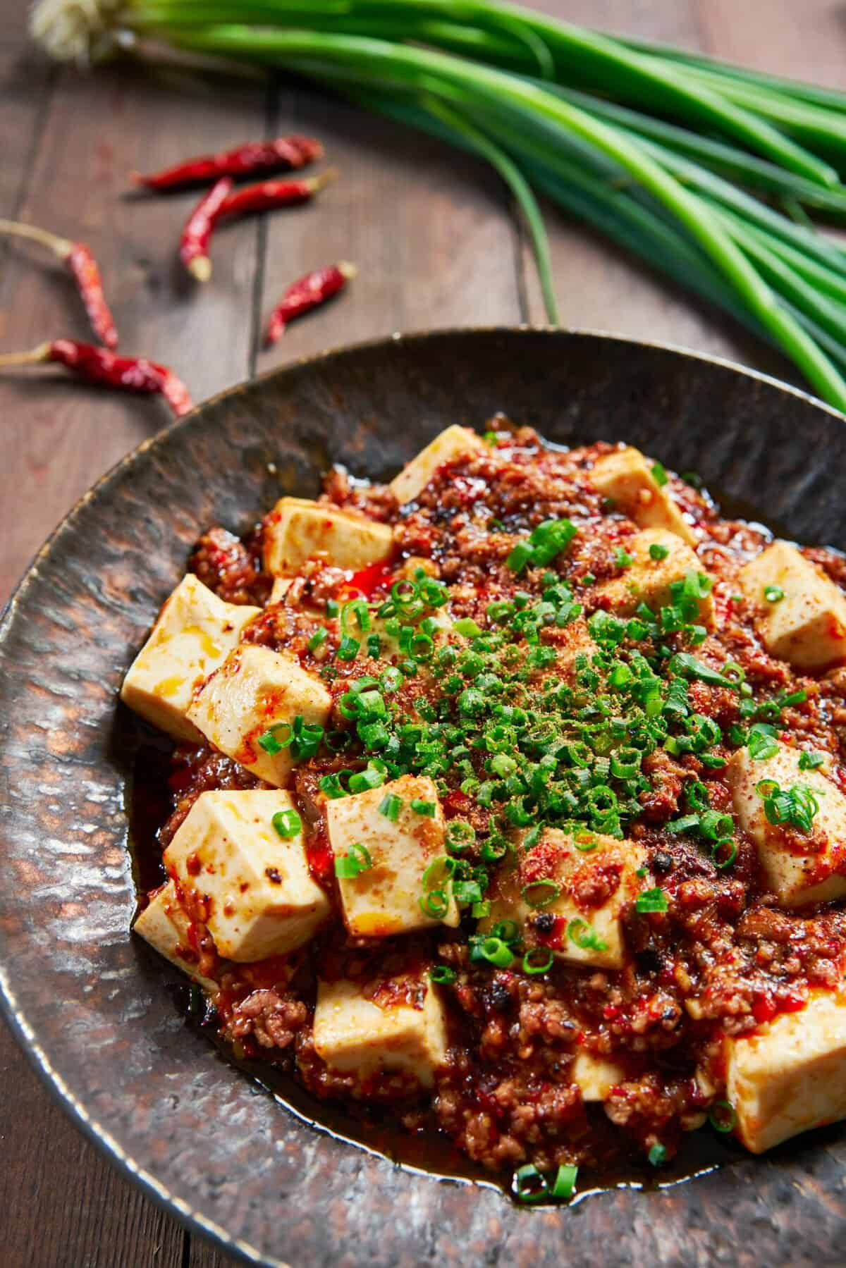 With custardy cubes of tofu draped in a tongue tingling spicy sauce, this Sichuan-style Mapo Tofu is the best tofu dish ever!