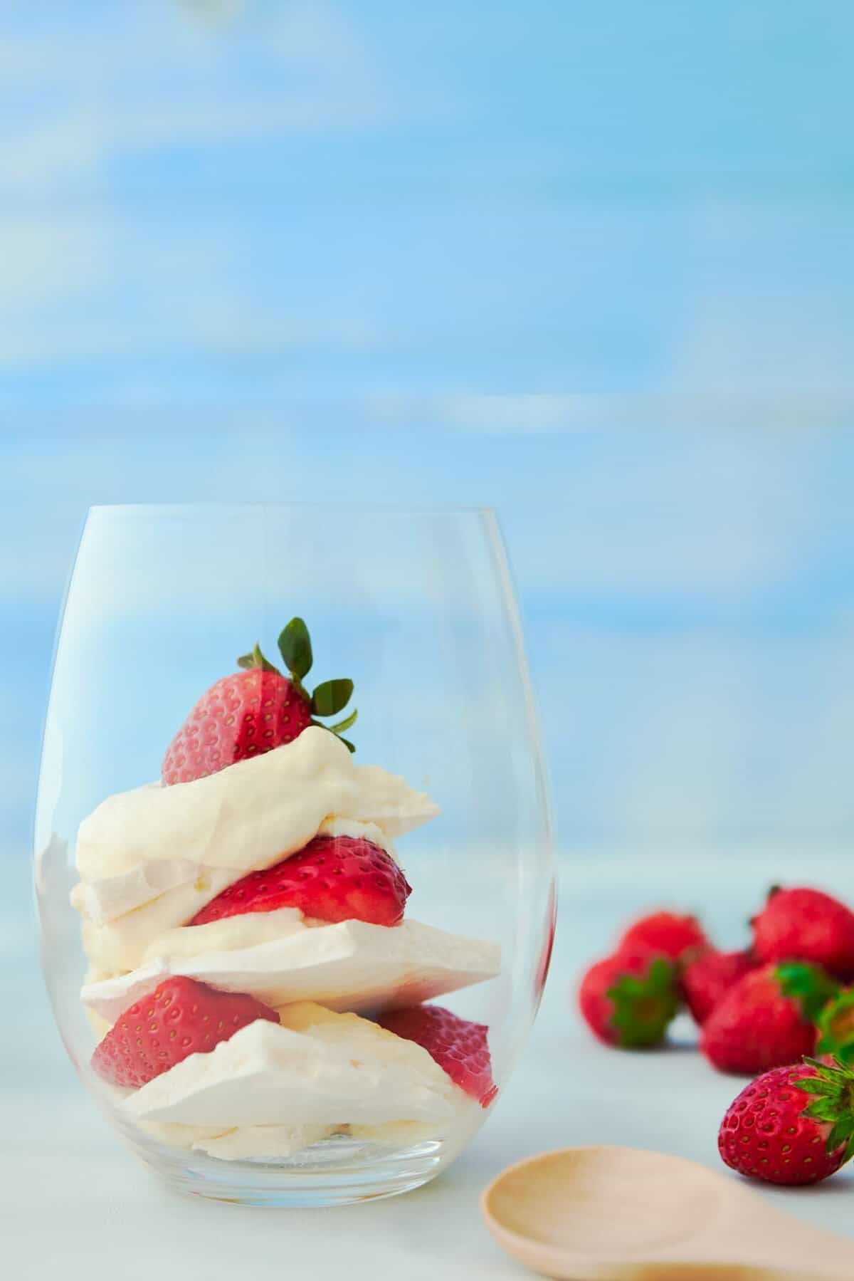 This Eton Mess recipe is a scrumptions British dessert made with layers of white chocolate cream, crisp meringue and strawberries.