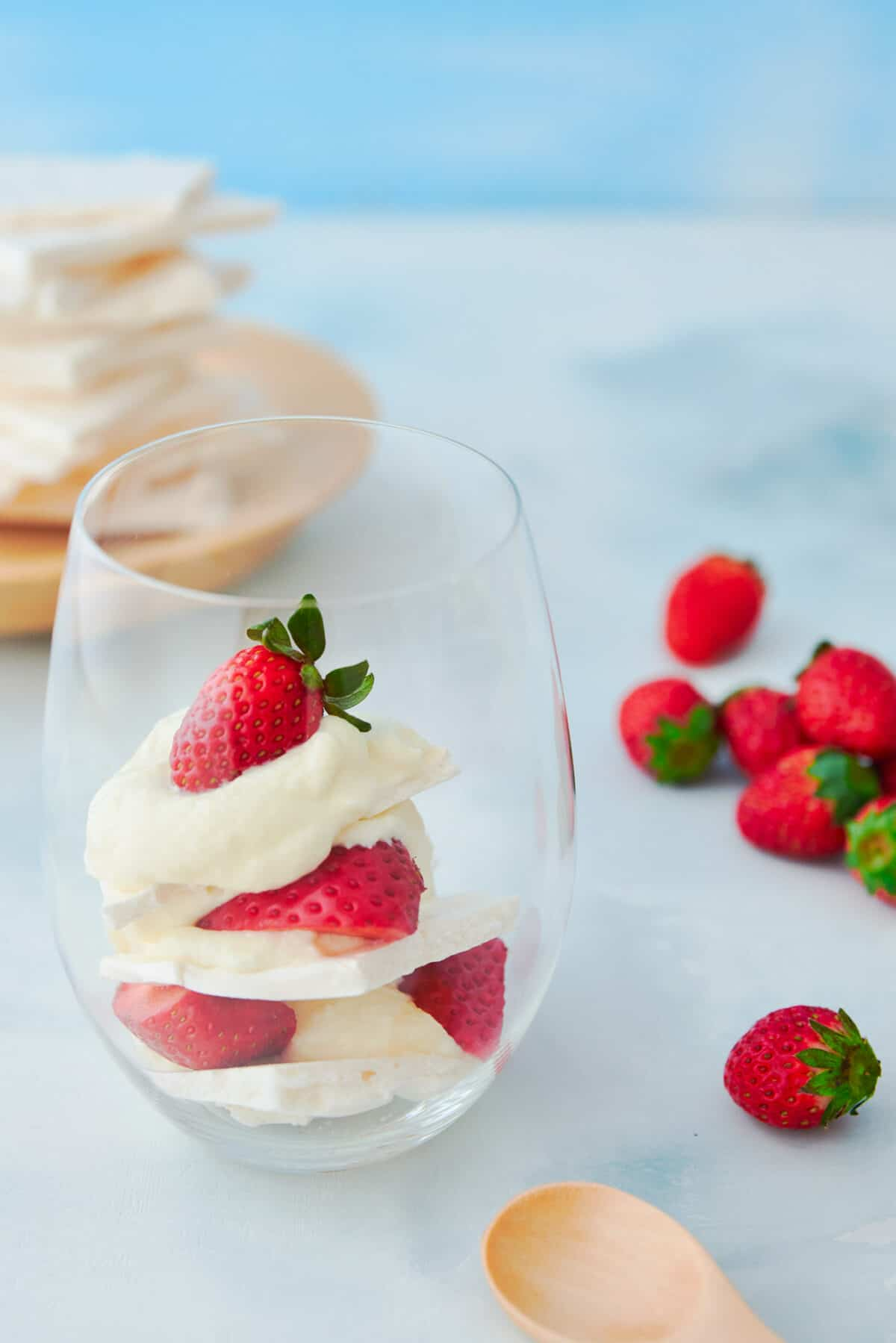 With fresh strawberries, white chocolate cream, and crisp meringue this Eton Mess recipe is a mind-blowinglh good dessert that's the perfect end to a spring dinner party.