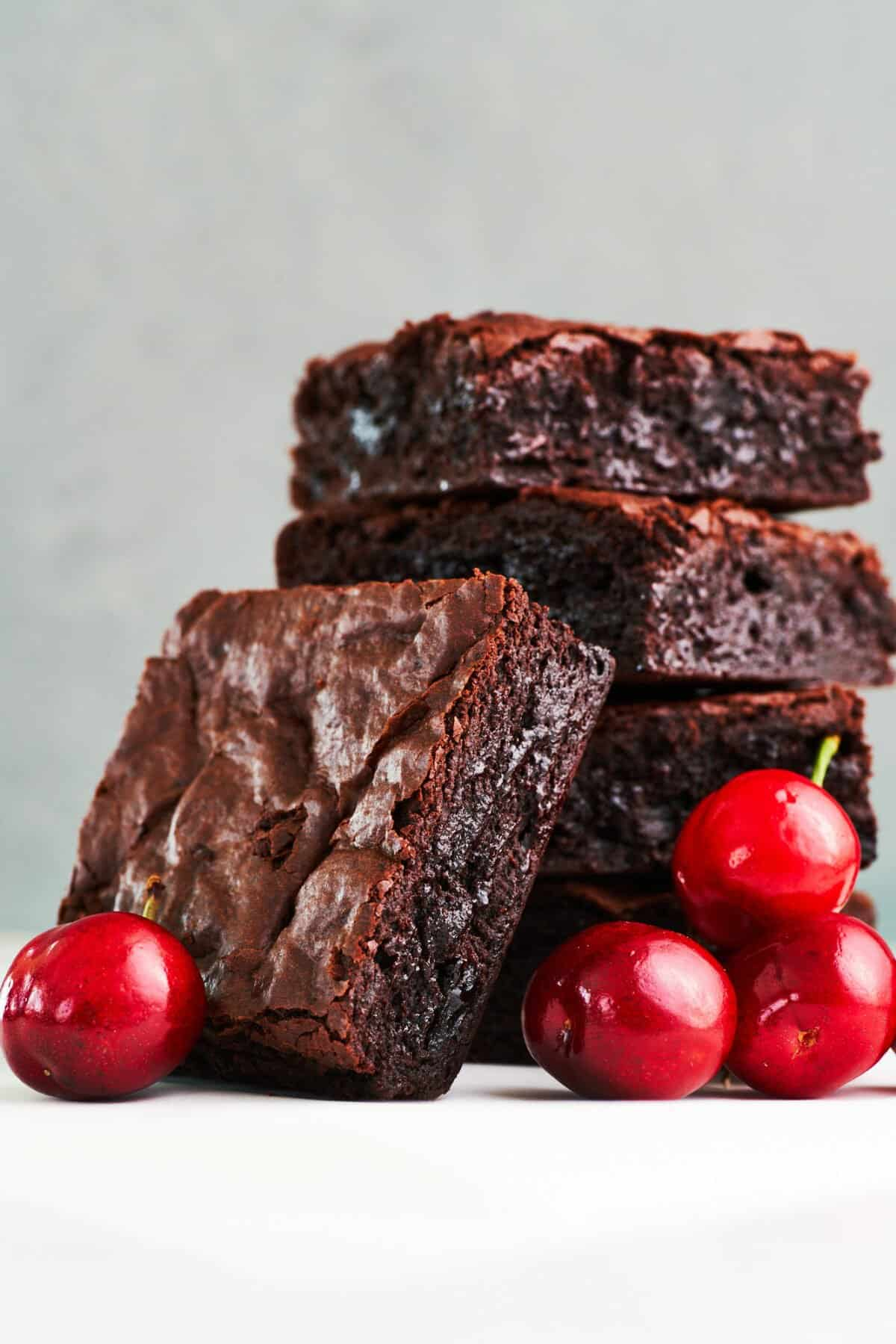 These perfect chocolate cherry brownies have a crisp shell on top and a decadent fudgy center, and they take less than 10 minutes to get in the oven.