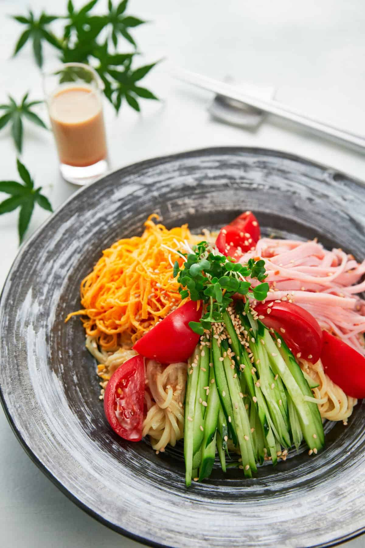 This cold ramen salad (Hiyashi Chuka) is the perfect light meal for a hot summer day. With loads of veggies and protein over a bed of chilled ramen noodles dressed with a creamy sesame vinaigrette, it's sure to wake your appetite on even the hottest of days.