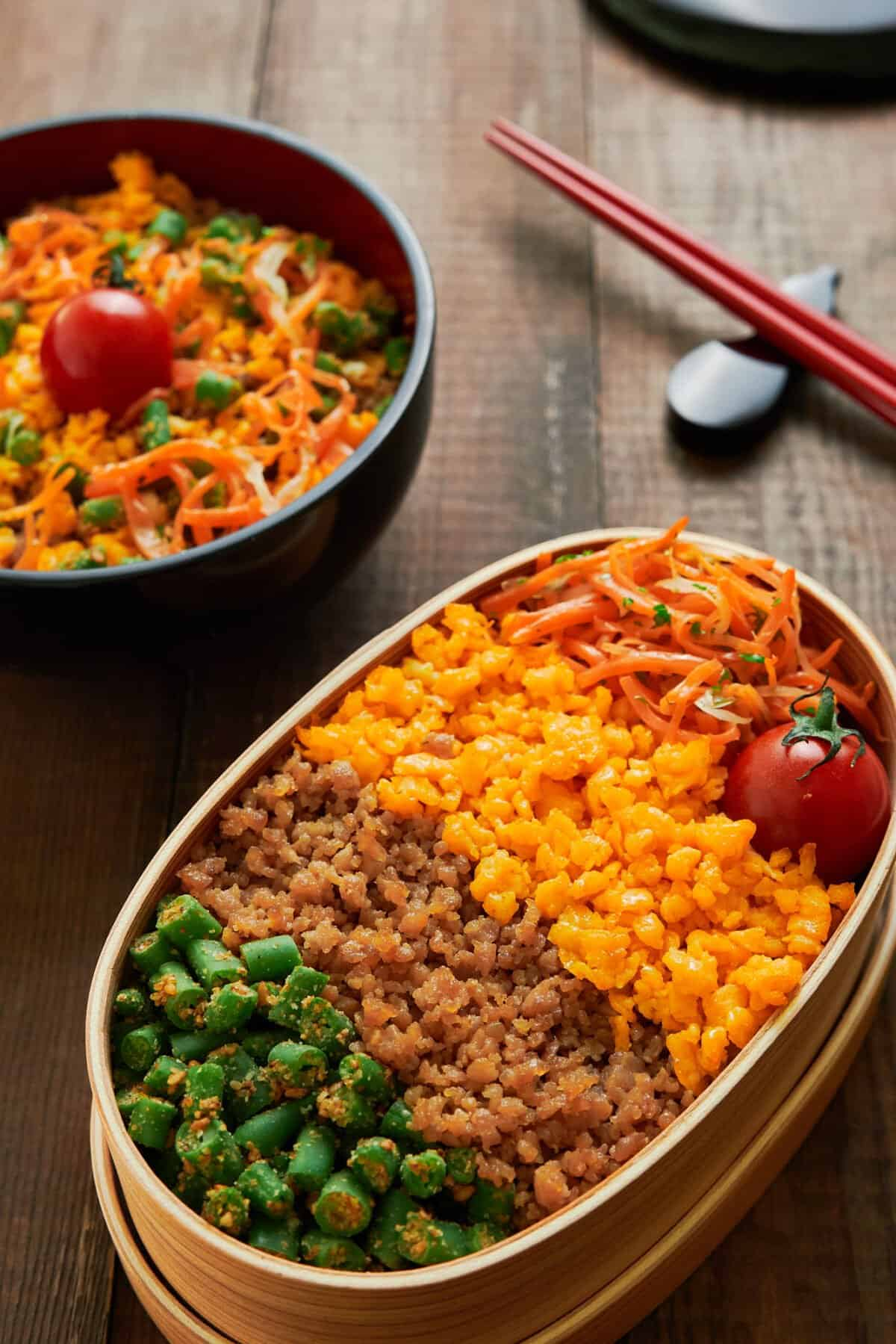 With a rainbow of chicken, eggs, and veggies over rice, this easy delicious Soboro Bento comes together for under $3 per serving from ingedients you probably have in your kitchen.