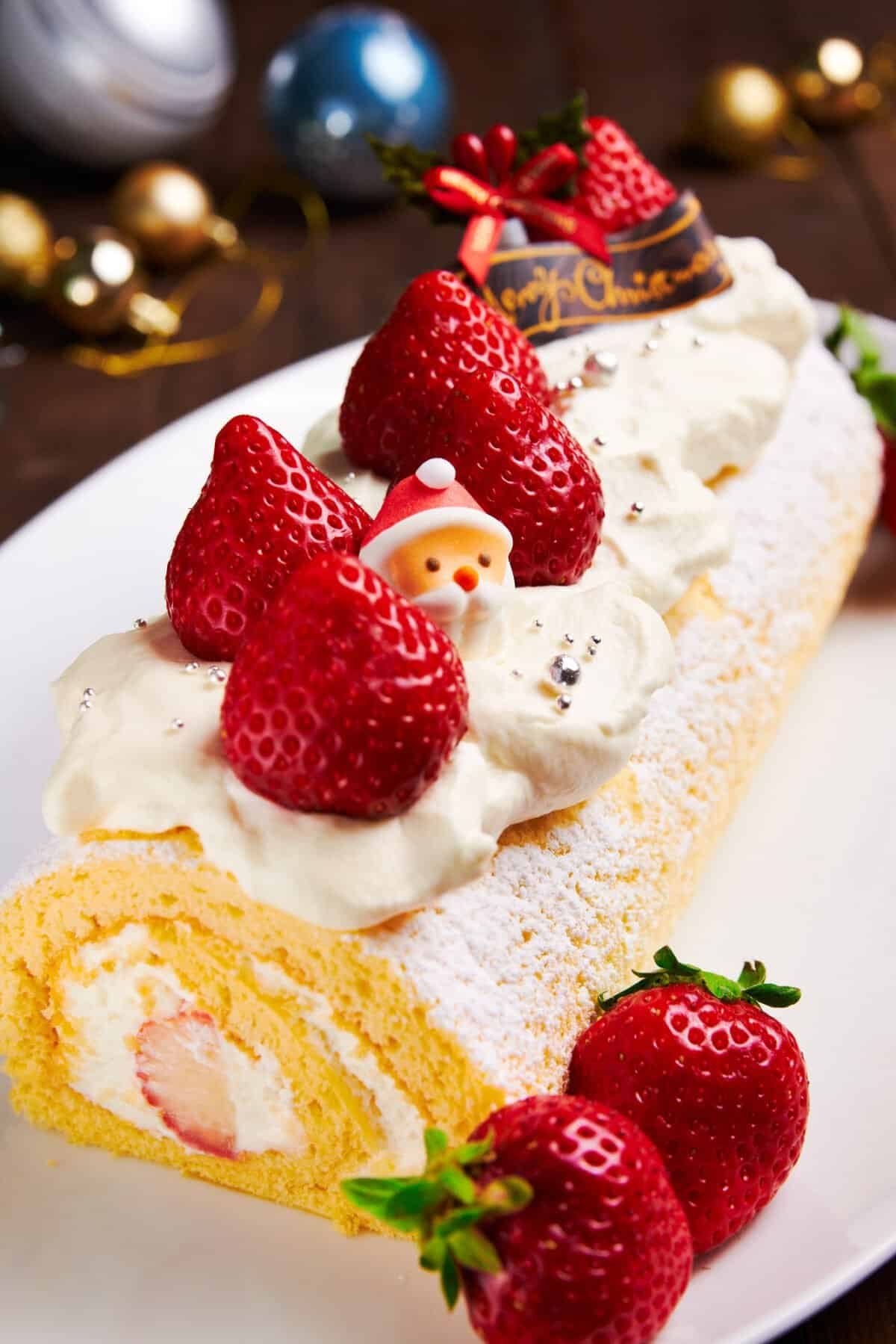 This mouthwatering Japanese Christmas cake is made with a tender spongecake rolled with stawberries and cream.