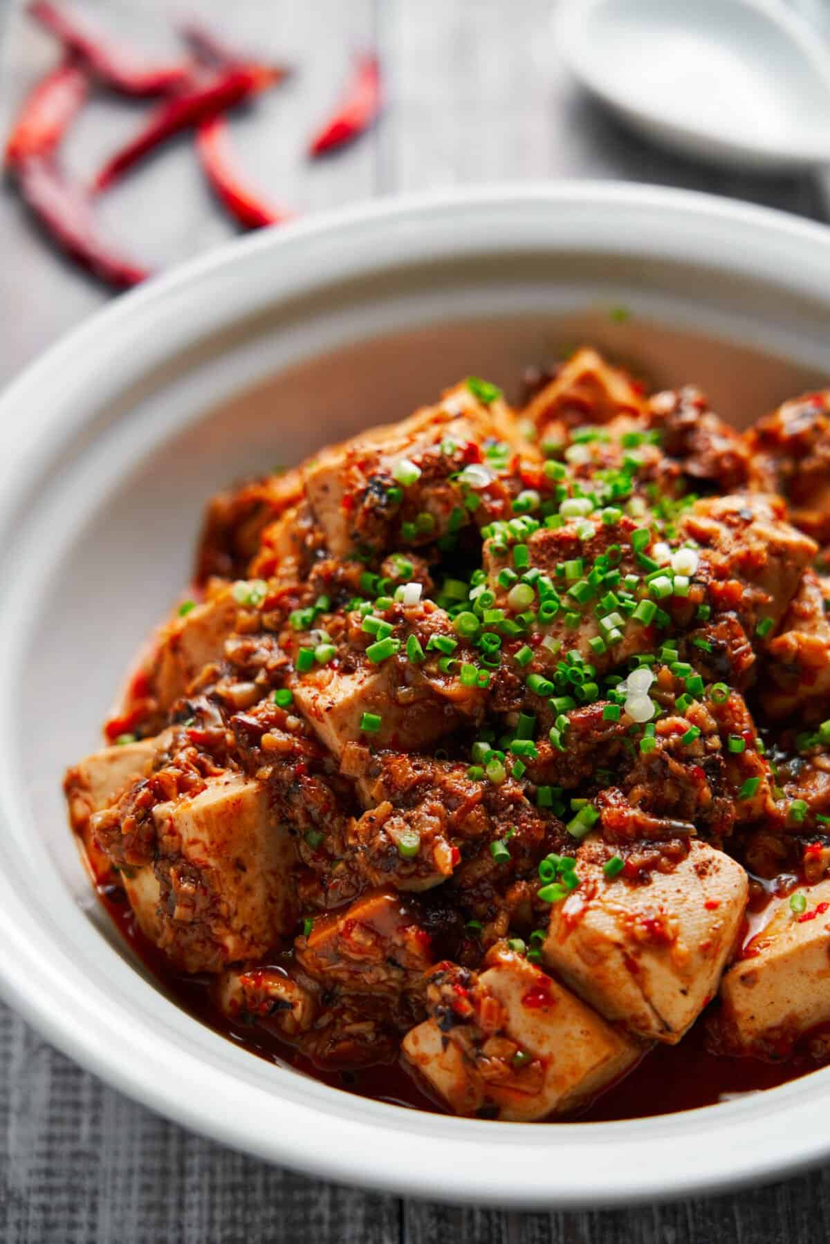 Spicy, flavorful, and satisfying, this plant-based Mapo Tofu includes a medley of ground mushrooms that give this Sichuan classic a meaty texture and flavor.
