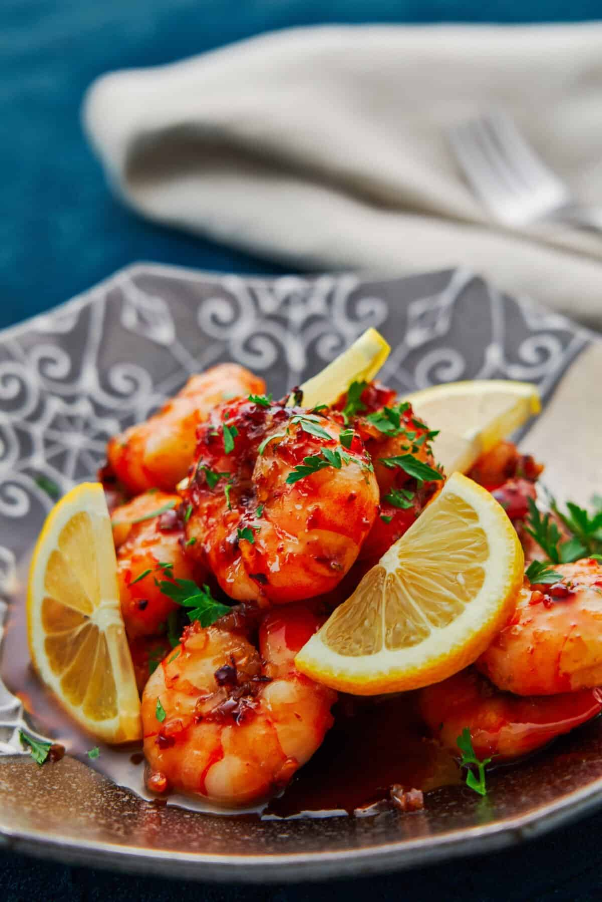 This easy honey garlic shrimp is coated in a mouthwatering sticky garlic glaze, and yet it comes together in minutes from just a handful of pantry staples.