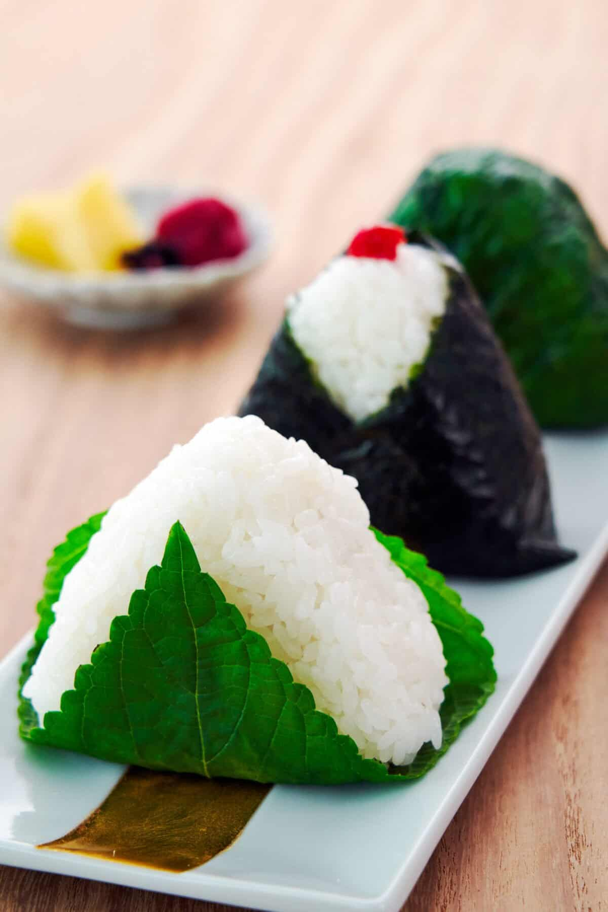 The ultimate guide to making Japanese Rice Balls, or onigiri, and shaping them into perfect triangles without a mold.