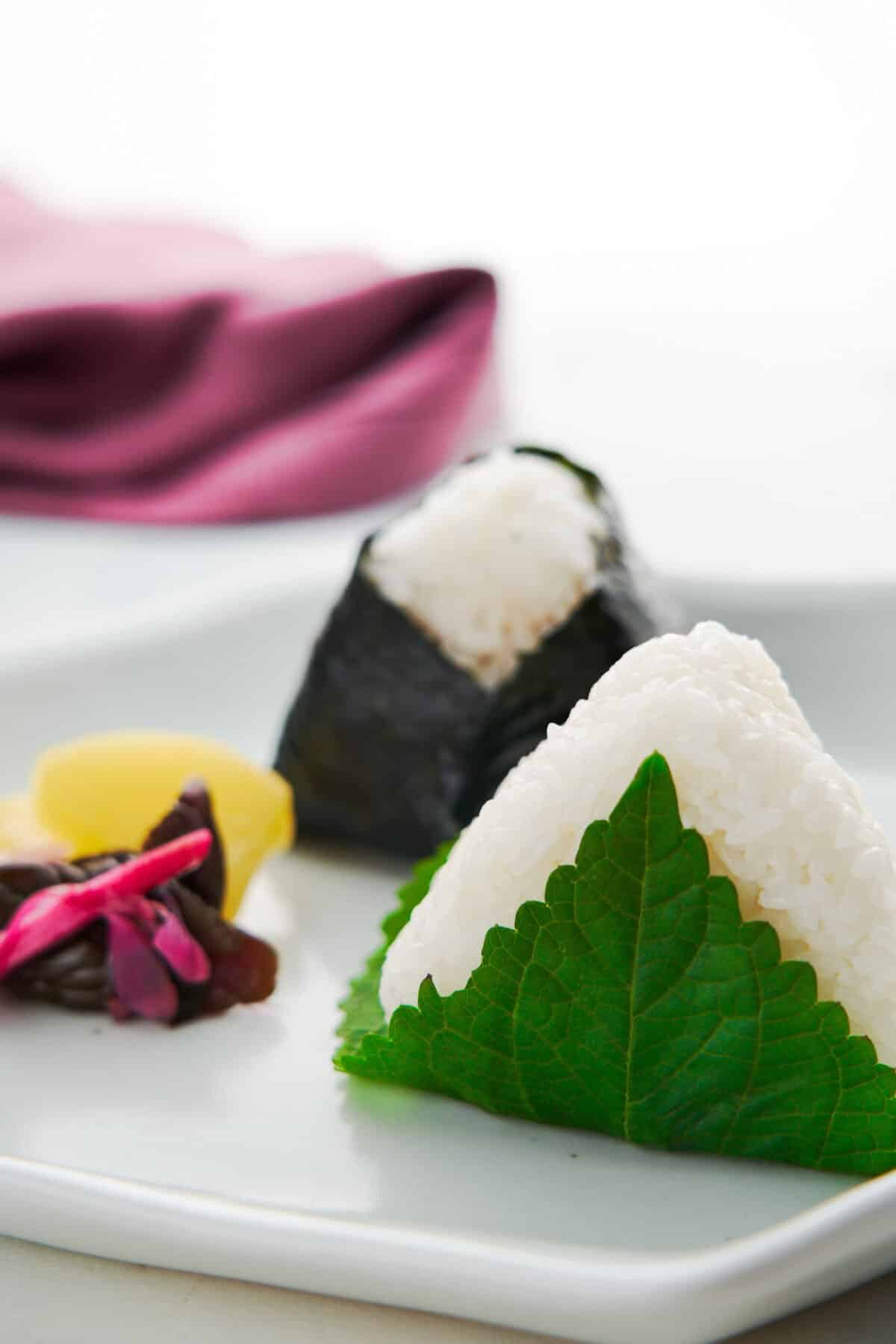 Tuna Mayo is a modern classic filling for onigiri rice balls that can be made with just canned tuna, mayonnaise and soy sauce. Learn everything you need to know to make these triangular Tuna Mayo Onigiri with this recipe.