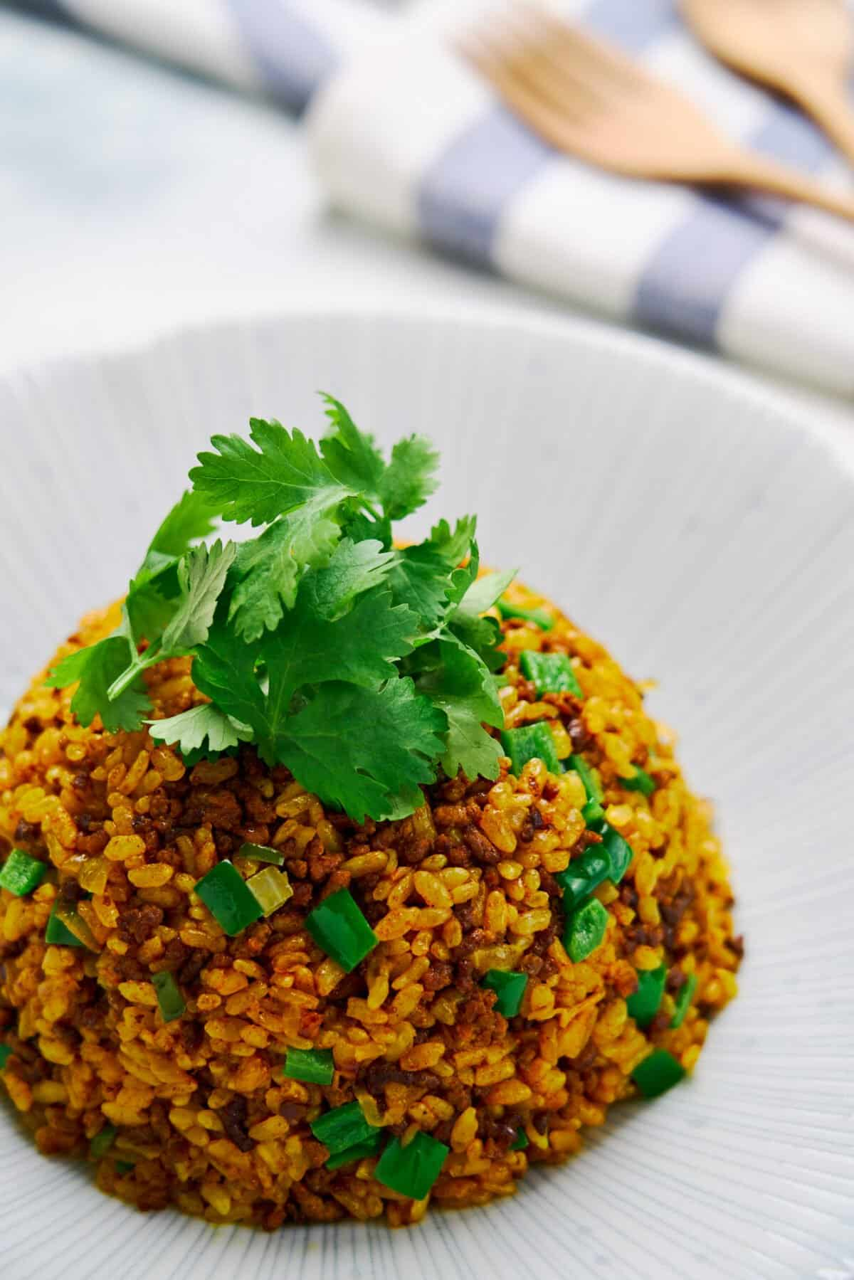 With ground beef and caramelized onions, this easy curry fried rice tastes like a big bubbling pot of Japanese Curry.