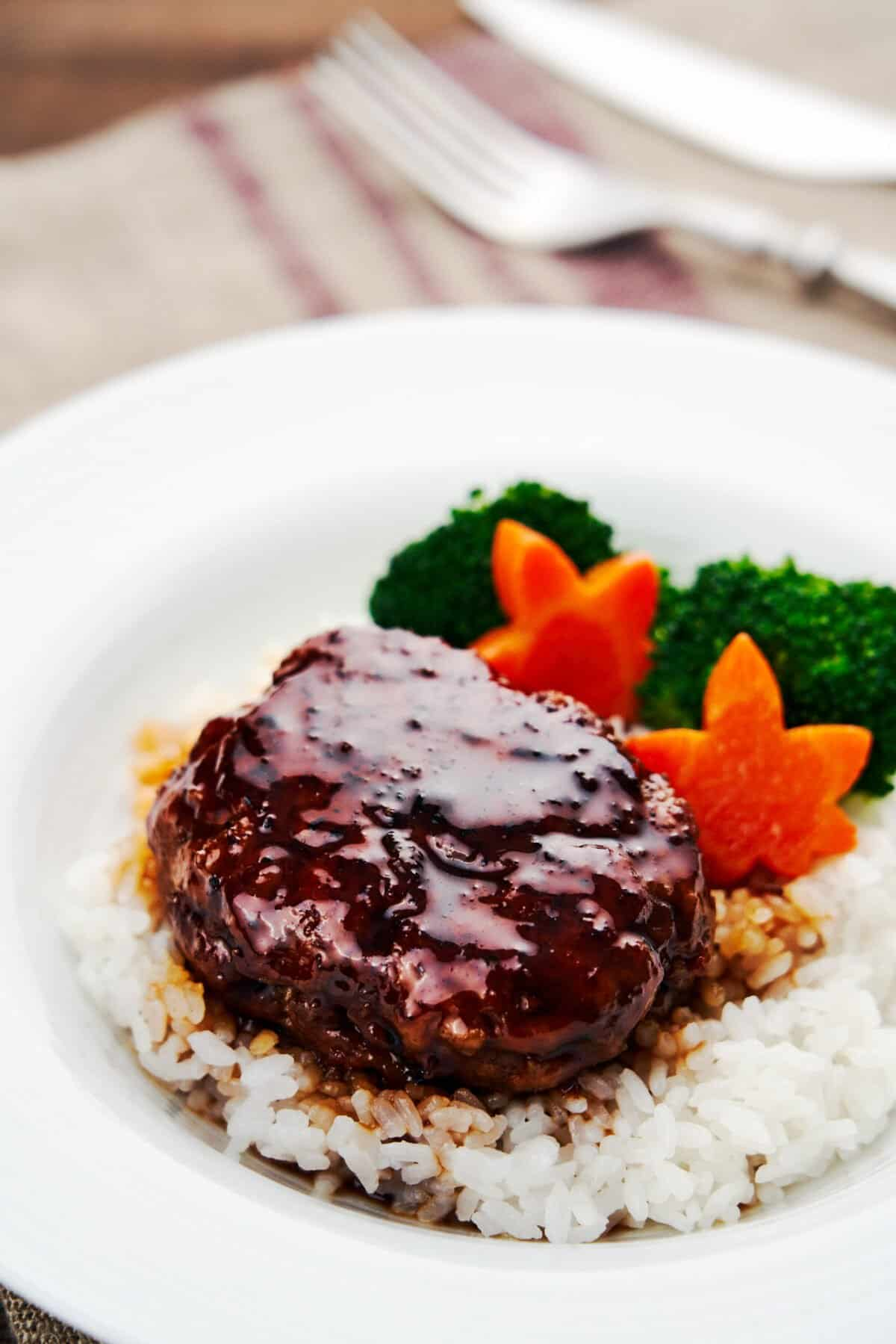 This mouthwatering Japanese Hamburg Steak recipe is glazed with an easy 3-ingredient teriyaki sauce.