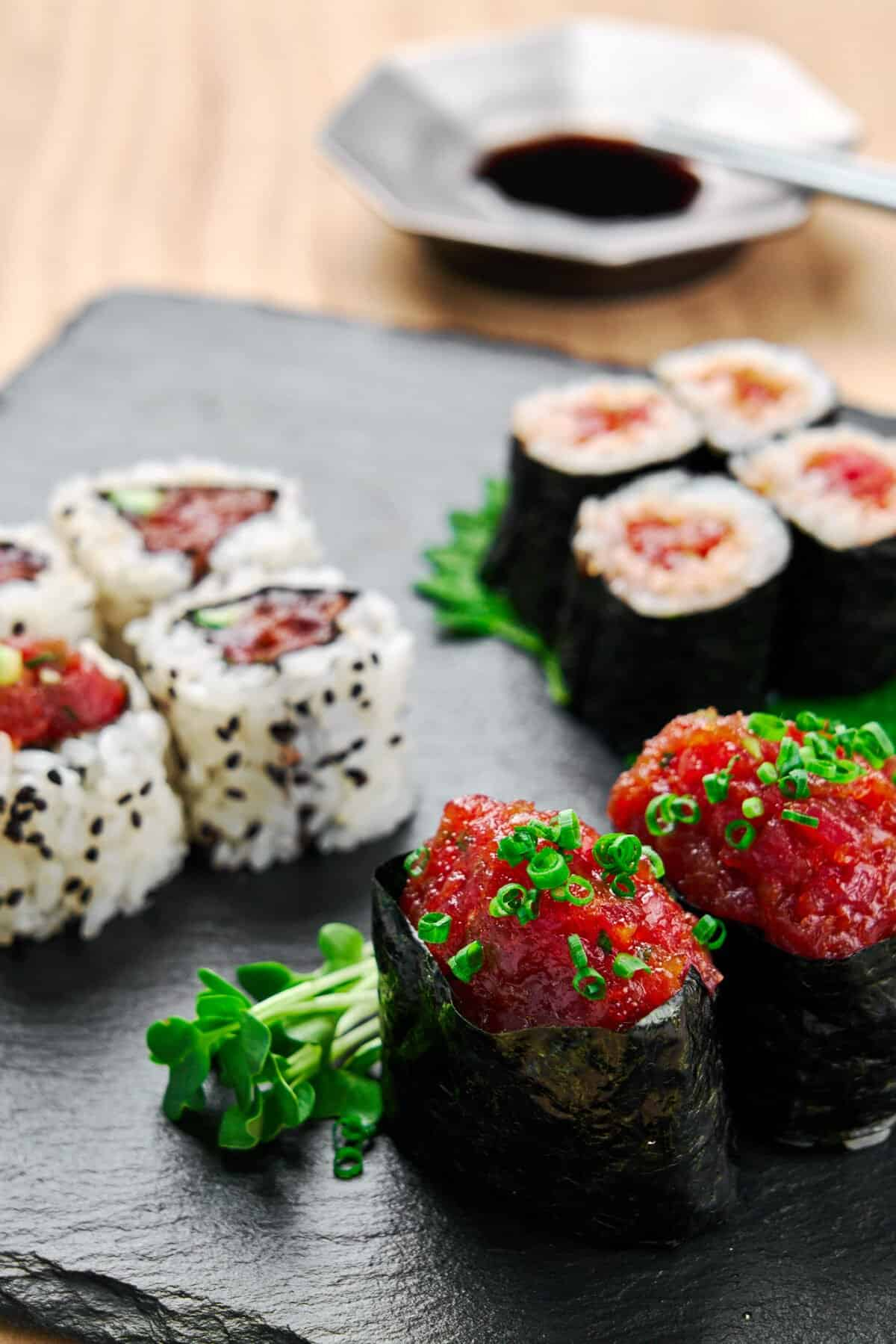 Make delicious spicy tuna rolls at home, just like your favorite sushi restaurant, with this easy to follow tutorial. Delicious spicy tuna filling recipe along with a step-by-step video on how to roll it 3 different ways.