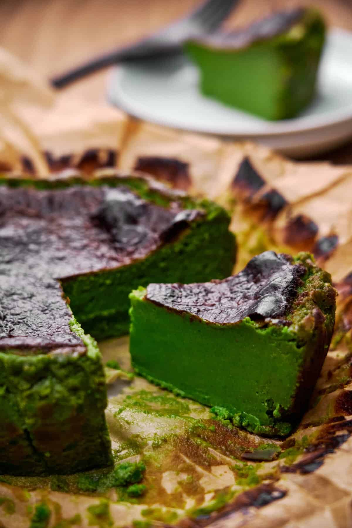 This Matcha Basque Cheesecake is as easy as blending the ingredients and baking them. Silky smooth inside and caramelized on the outside, the matcha powder gives it a vibrant green hue and green tea flavor.