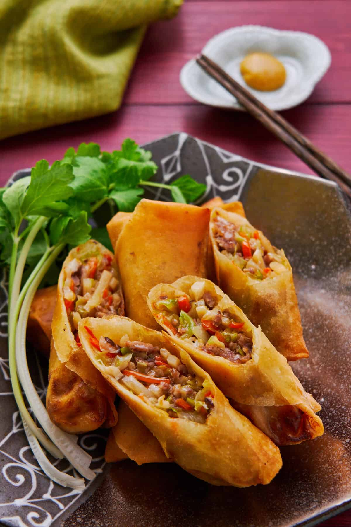 Shatteringly crisp on the outside and loaded with vegetables, mushrooms, and pork in a savory gravy on the inside, this self-saucing Japanese-style spring roll is mouthwateringly good!