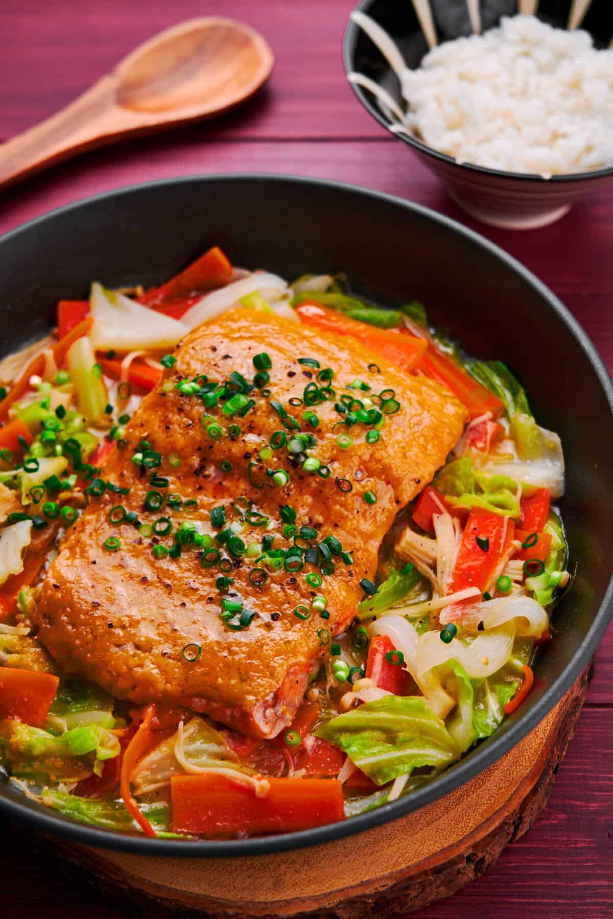 Melt-in-your-mouth salmon steamed on a bed of cabbage, carrots, and mushrooms with miso butter sauce.