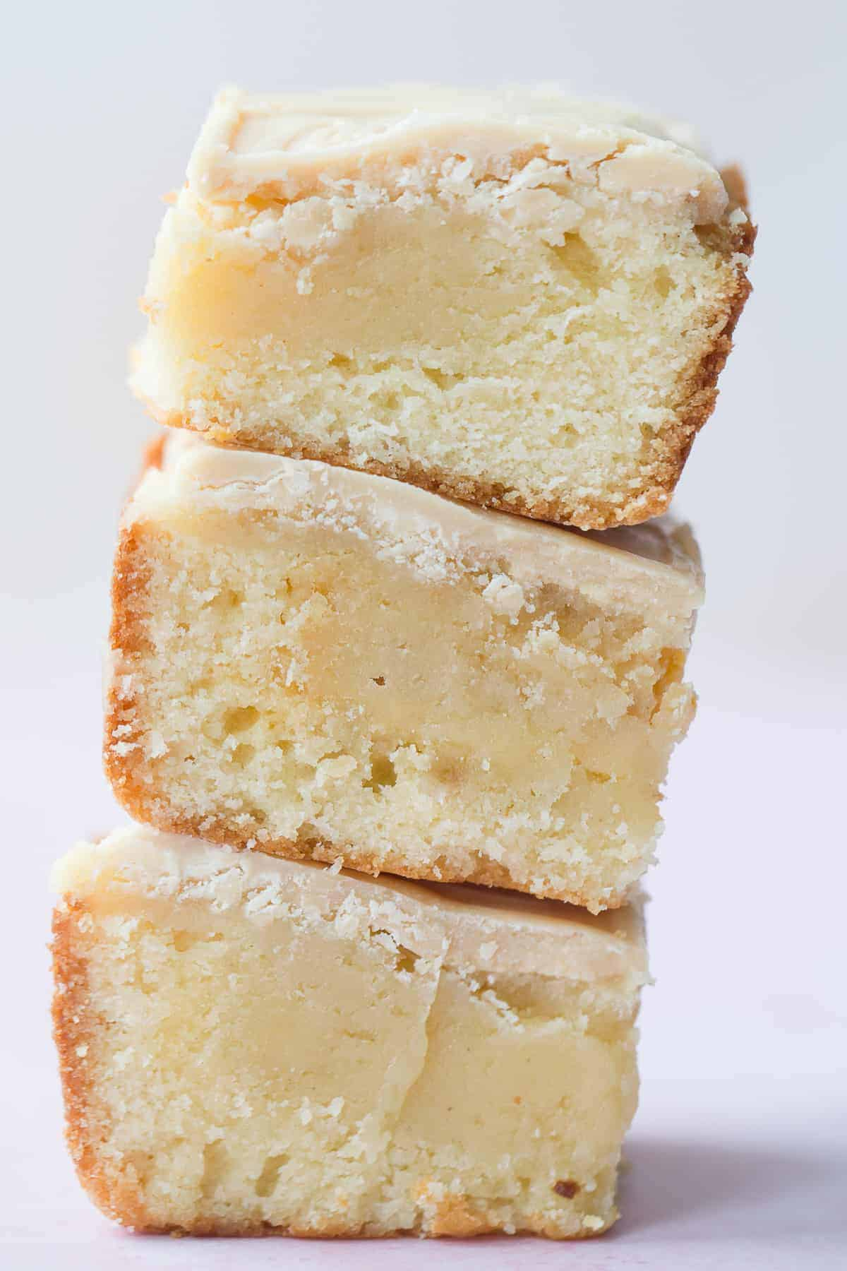 Side view of 3 blondies stacked on top of each other.