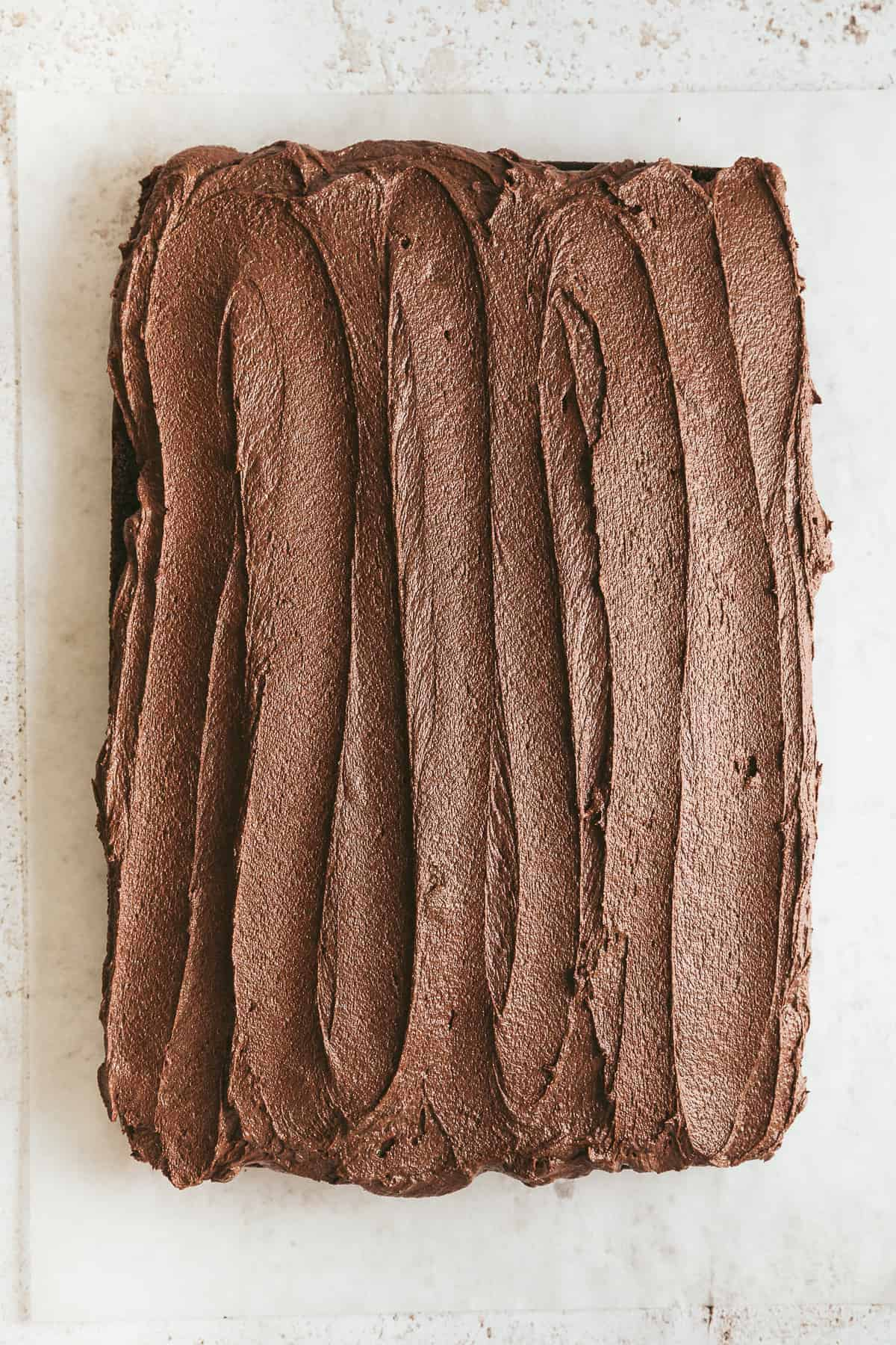Chocolate buttercream icing on top of a cake.