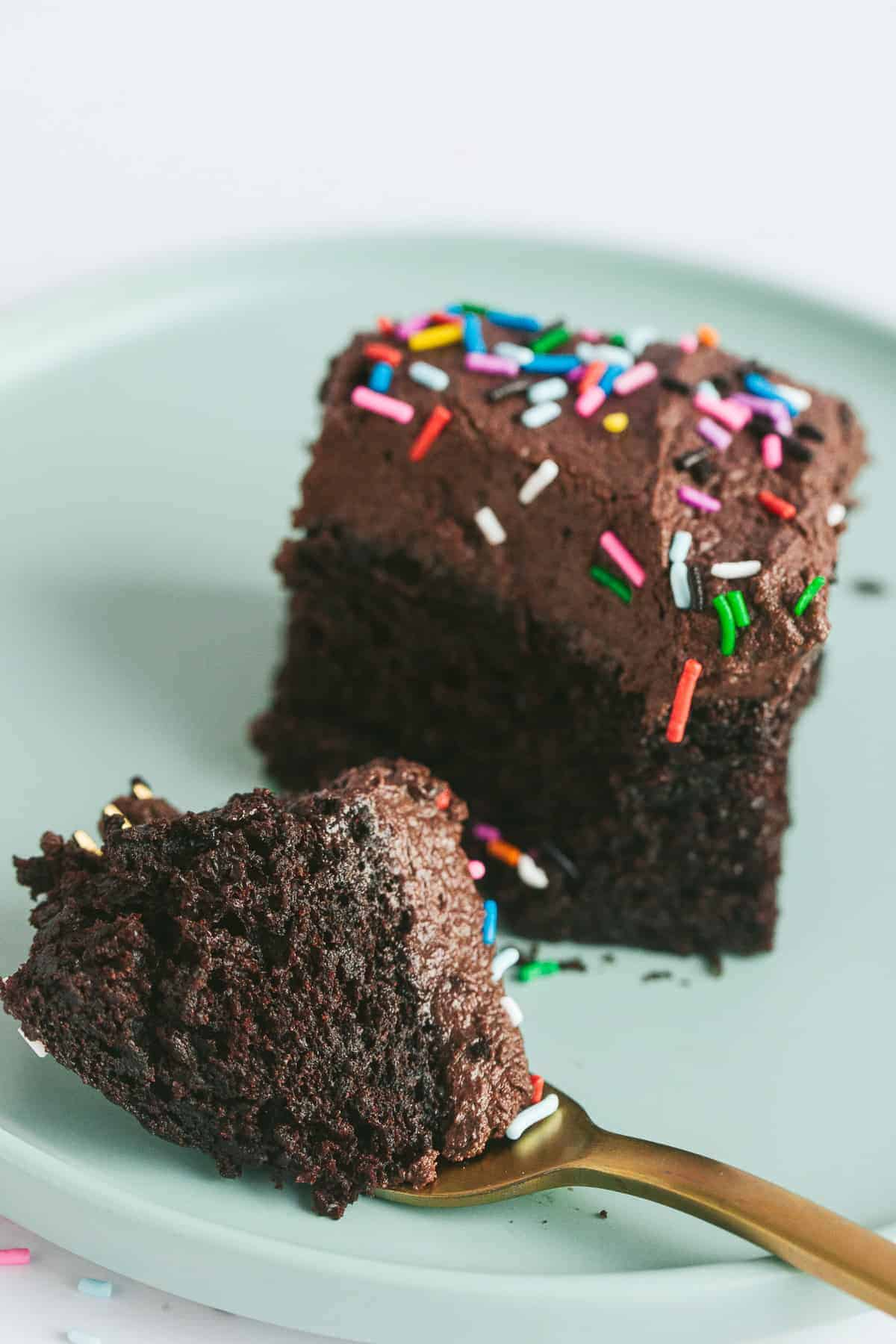 A slice of chocolate cake covered with chocolate buttercream.
