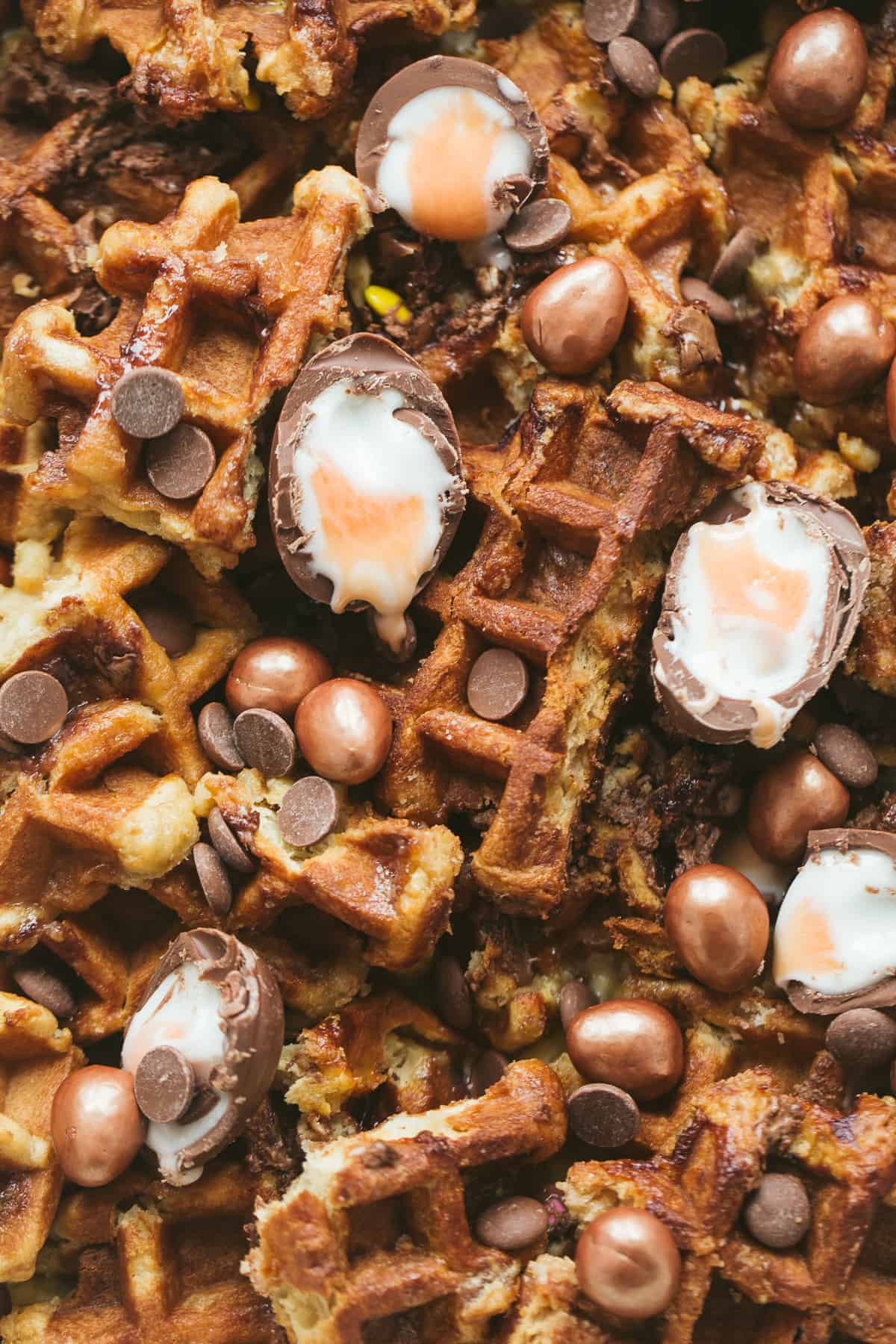 Baked waffles with Cadbury Creme Eggs and Galaxy Enchanted Eggs and custard.