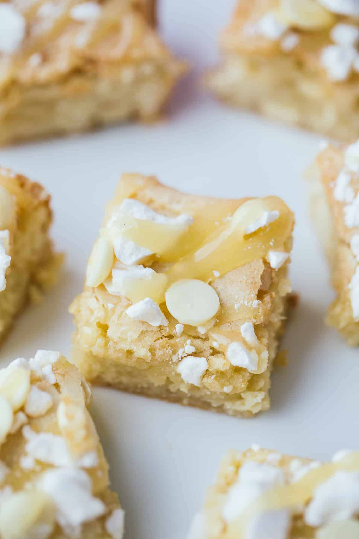 A white chocolate blondie with lemon curd and meringue.