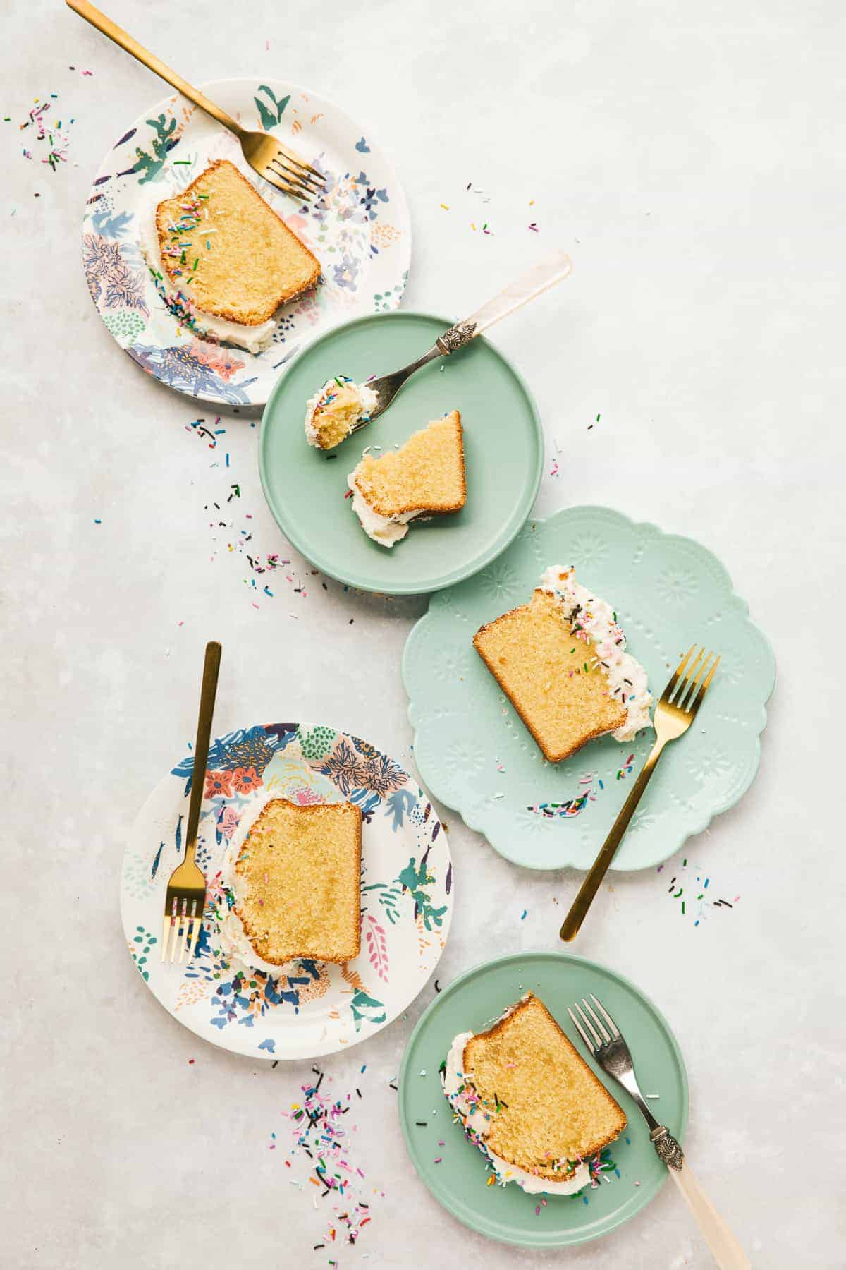 Slices of Vanilla Cake on different colour plates.