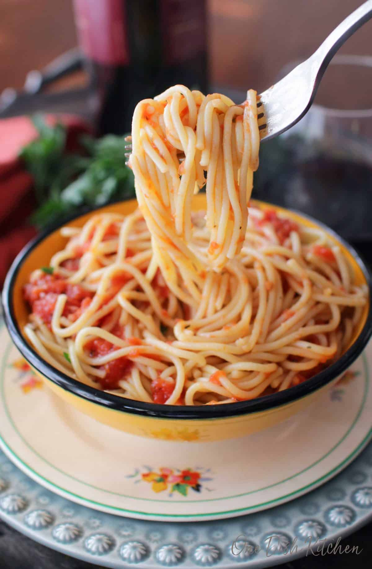 A closeup of spaghetti hanging from a fork